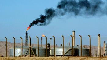 http://www.trbimg.com/img-53a16397/turbine/la-fg-iraq-oil-field-attacked-20140618-001/350/16x9