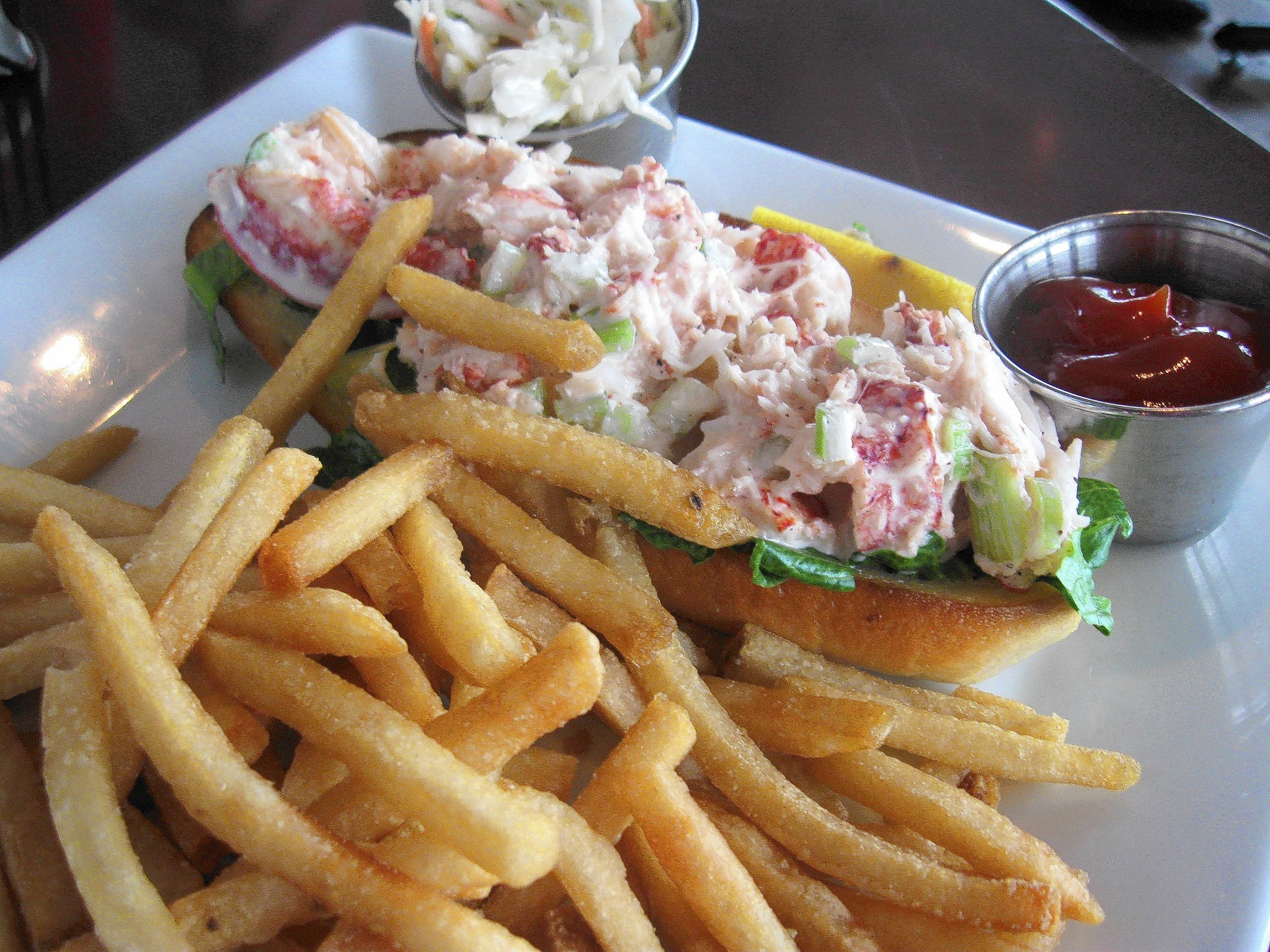 The fork-and-knife lobster roll is an open-faced affair lots of lobster and chopped celery lightly bound in mayonnaise. Information here.