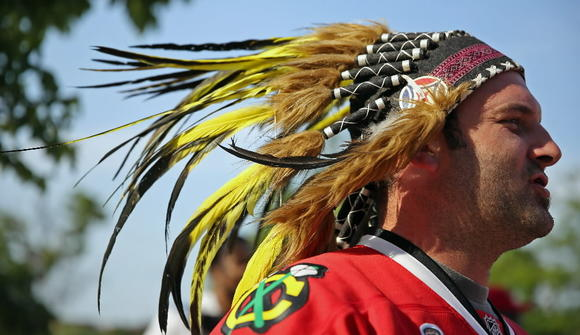 Mark Lagace of Calgary, Alberta, wears a fake Native Ame