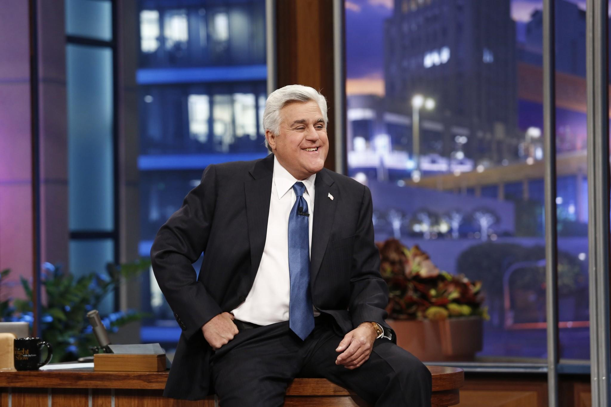"Jay Leno sits on his desk on his final night hosting ""The Tonight Show with Jay Leno."""
