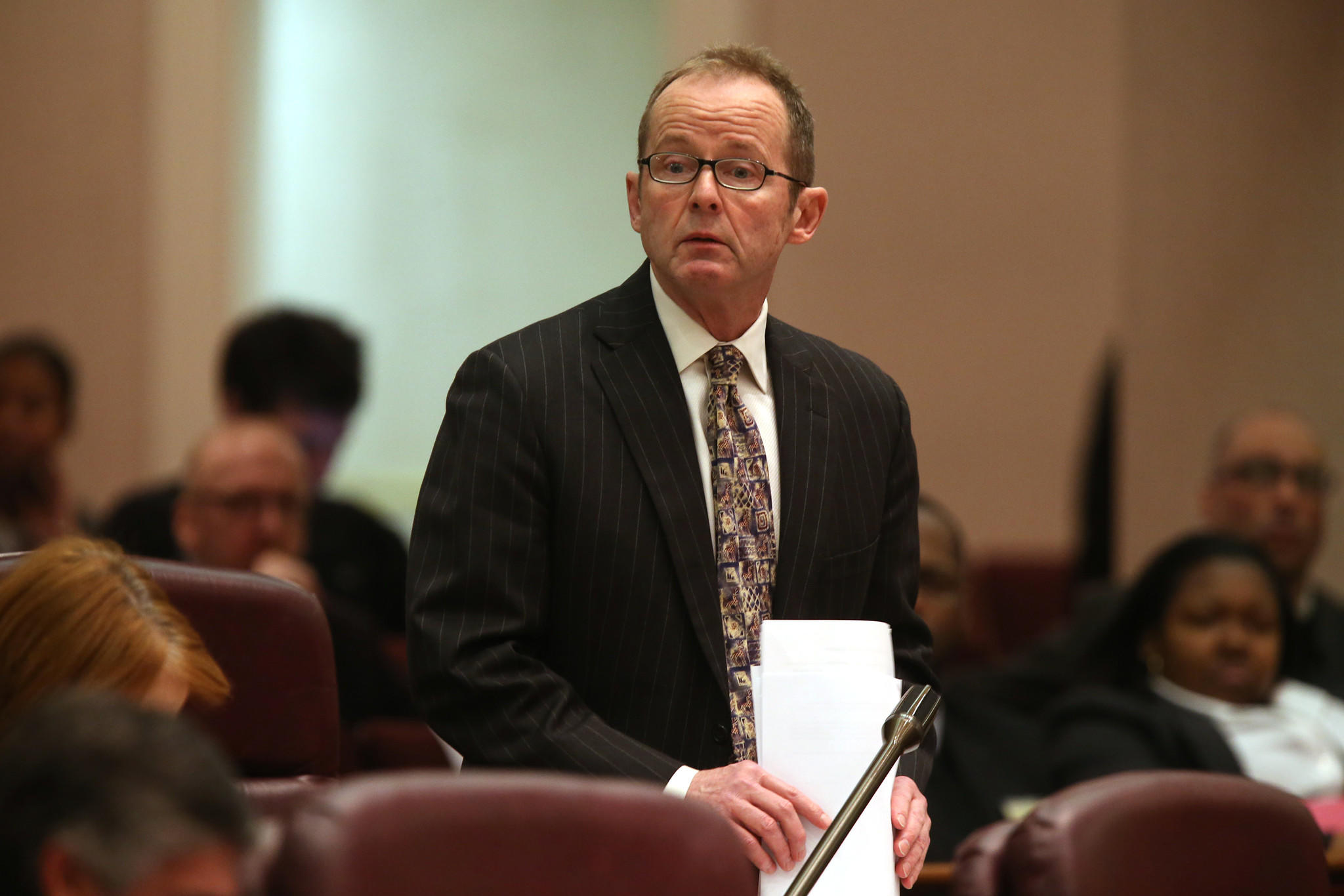 Ald. Thomas Tunney, 44th, speaks out on Wrigley Field plans during a city council meeting, Wednesday, Dec. 11, 2013.