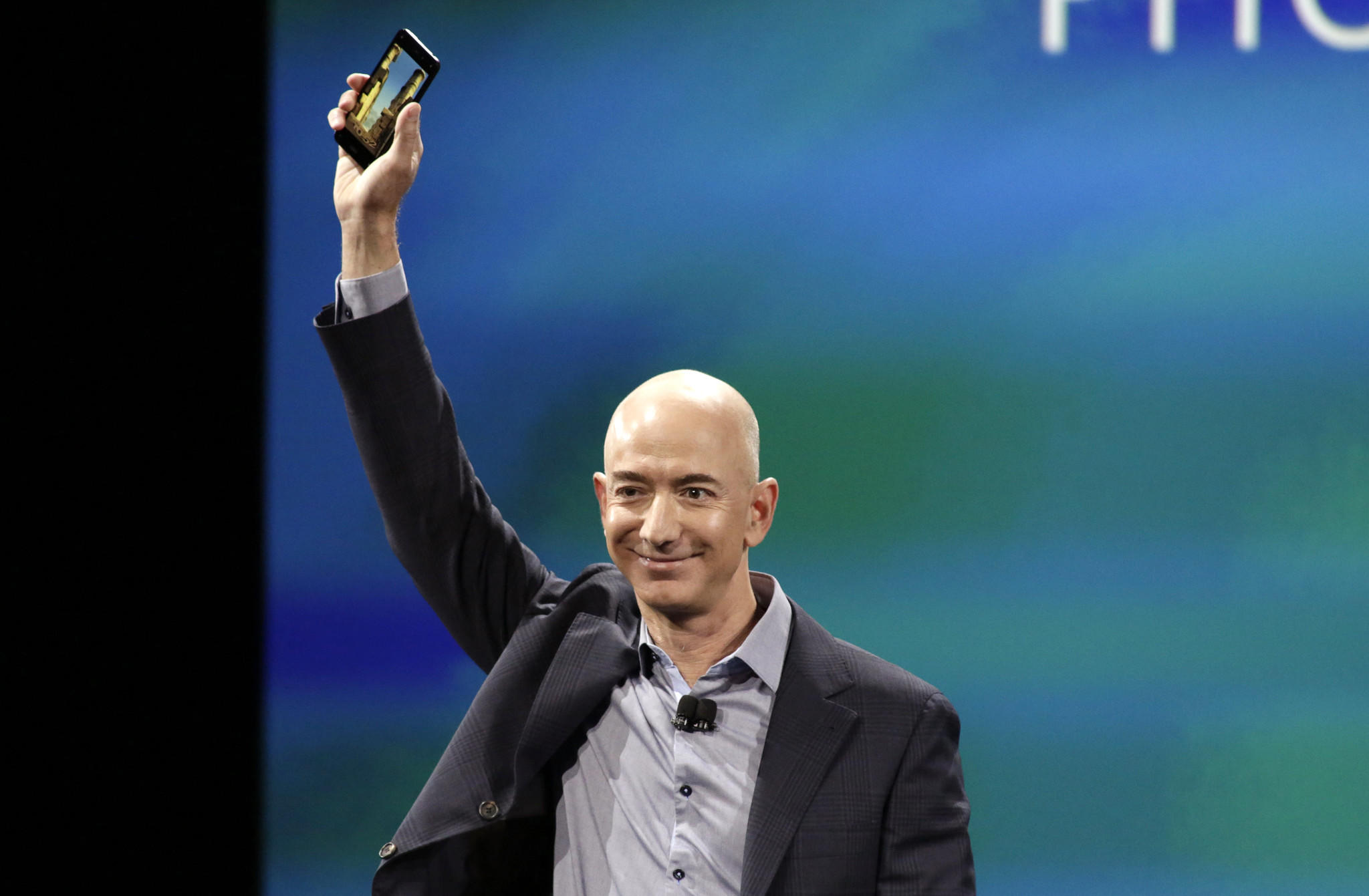 Amazon CEO Jeff Bezos shows off his company's new smartphone, the Fire Phone, at a news conference in Seattle, Washington.