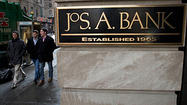 Men's Wearhouse closes deal to buy Jos. A. Bank
