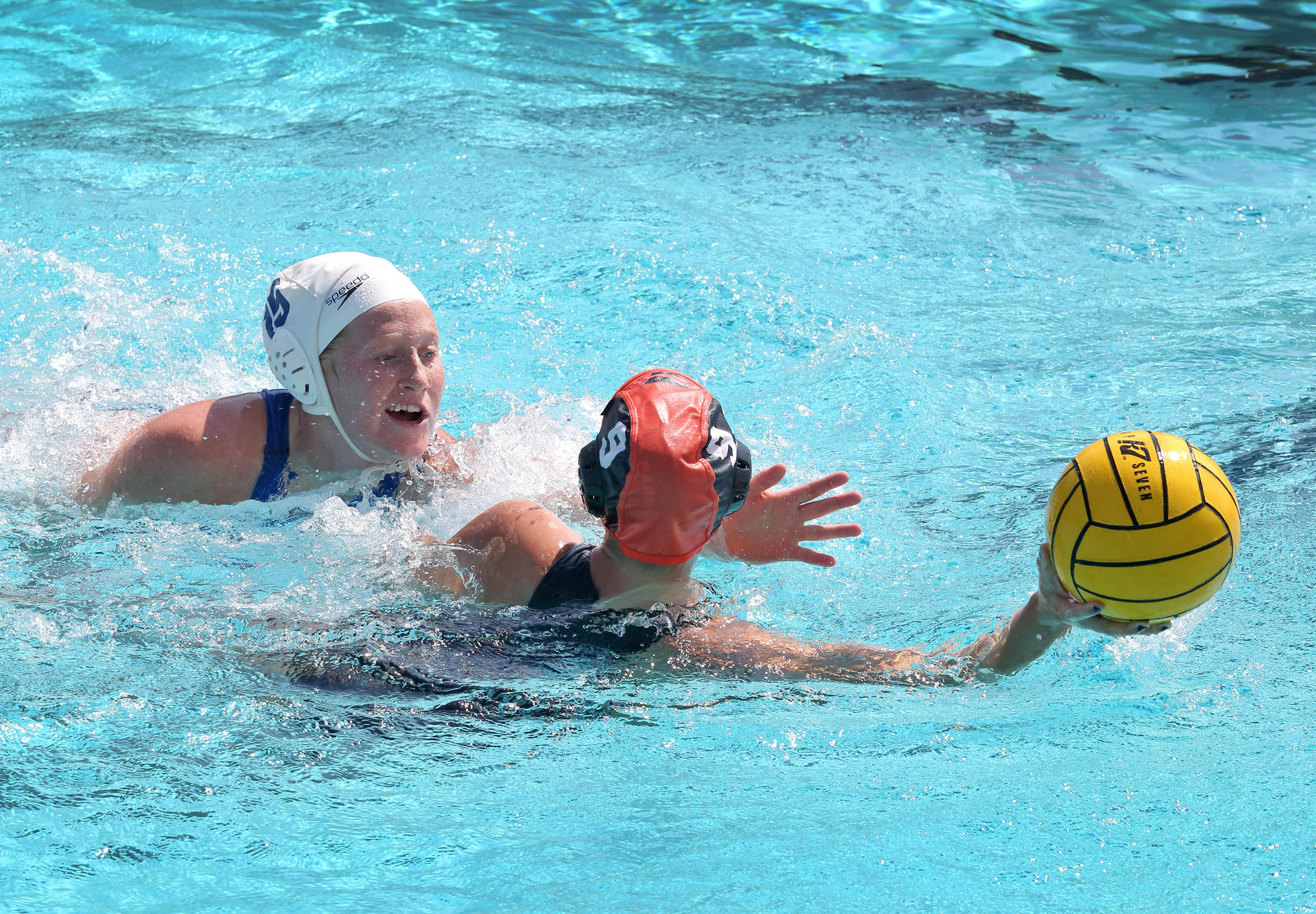 Alexis Moraitis, from Westminster Academy, left, and Caroline Alessandro, from Winter Park, are fighting for the ball during the state girls water polo quarterfinals.