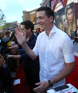 Oliver and James (background) Phelps, who portray the Weasley twins, during the red carpet VIP preview ceremony at the Wizarding World of Harry Potter - Diagon Alley -  Wednesday night, June 18, 2014, at Universal Studios Florida in Orlando.   (Joe Burbank/Orlando Sentinel) B583808824Z.1