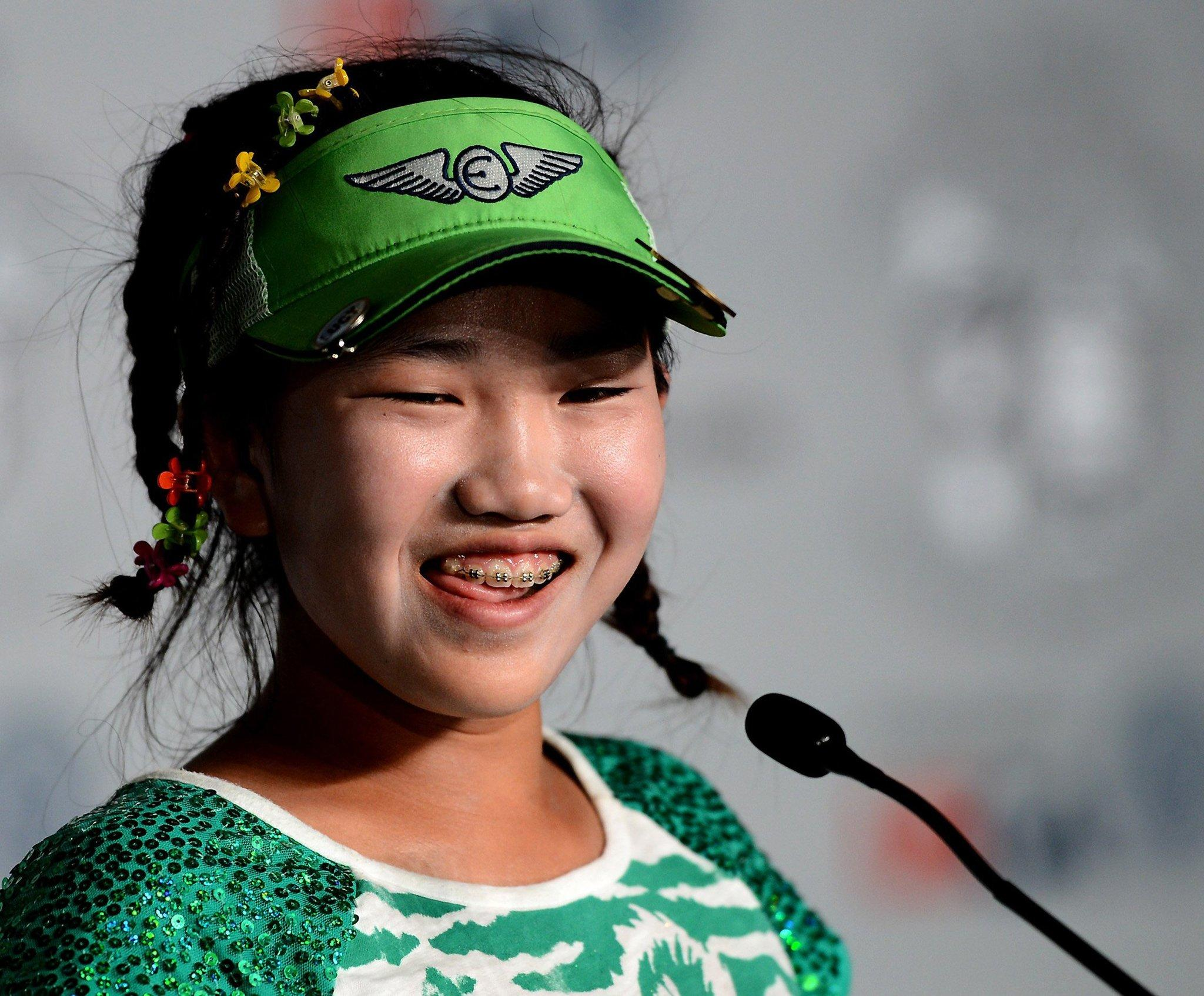 Lucy Li, 11, meets the media Tuesday.