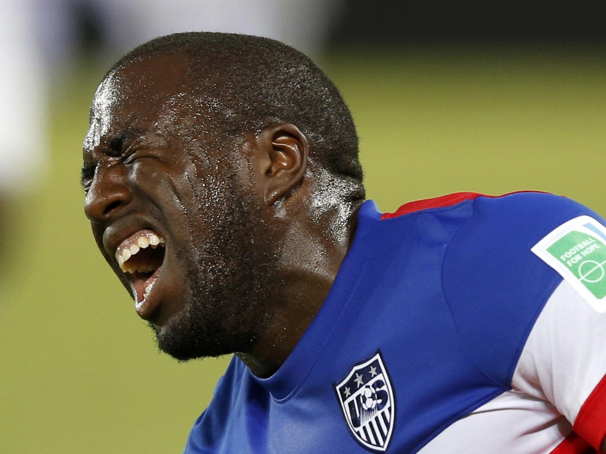 Jozy Altidore of the U.S. grimaces after sustaining an injury during their 2014 World Cup soccer match against Ghana.