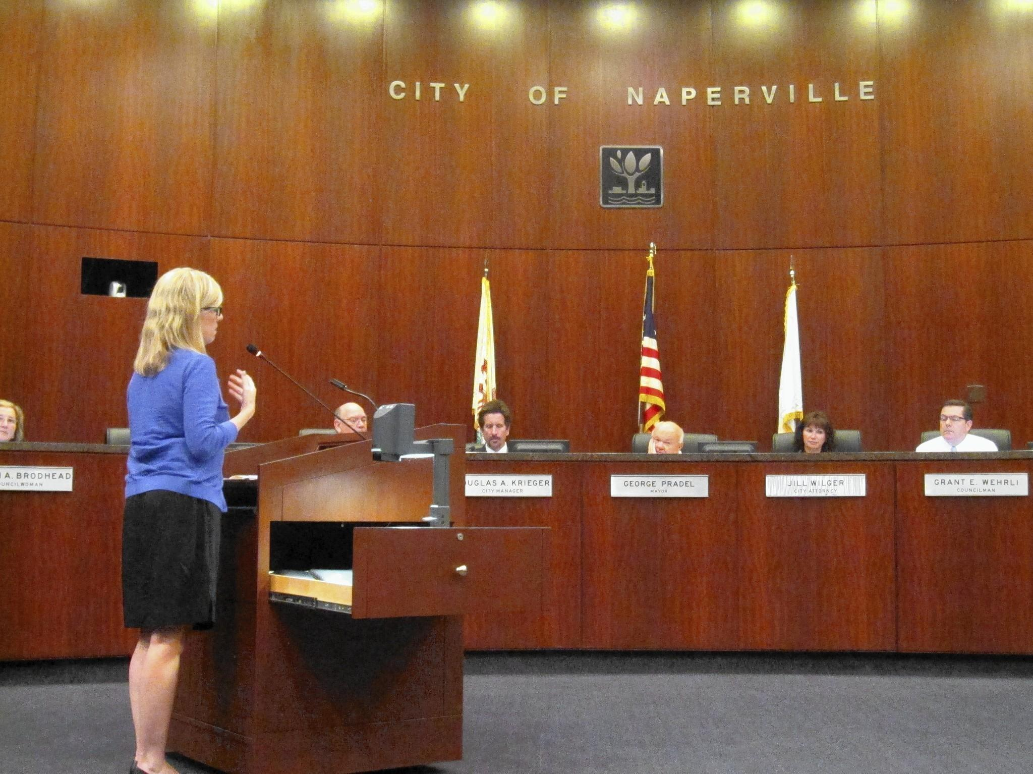 Downtown Naperville Alliance Executive Director Katie Wood presents plans for a downtown sound system to the Naperville City Council.