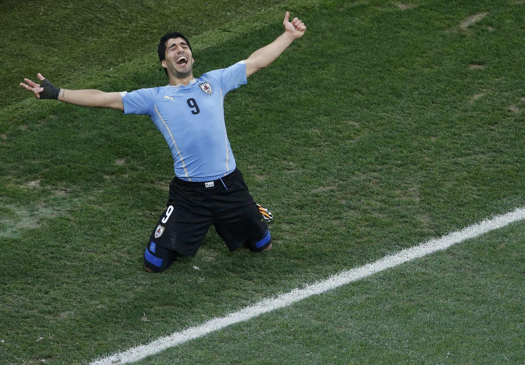 Uruguay's Luis Suarez celebrates scoring his team's second goal against England Thursday.