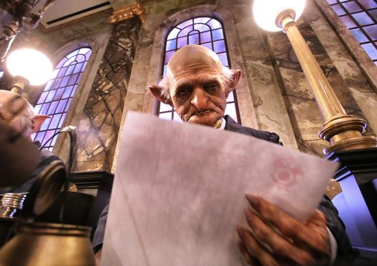 An animatronic bank clerk, at Gringotts Wizarding Bank, during the media preview at the Wizarding World of Harry Potter - Diagon Alley -  Thursday, June 19, 2014, at Universal Studios Florida in Orlando.   (Joe Burbank/Orlando Sentinel) B583808825Z.1