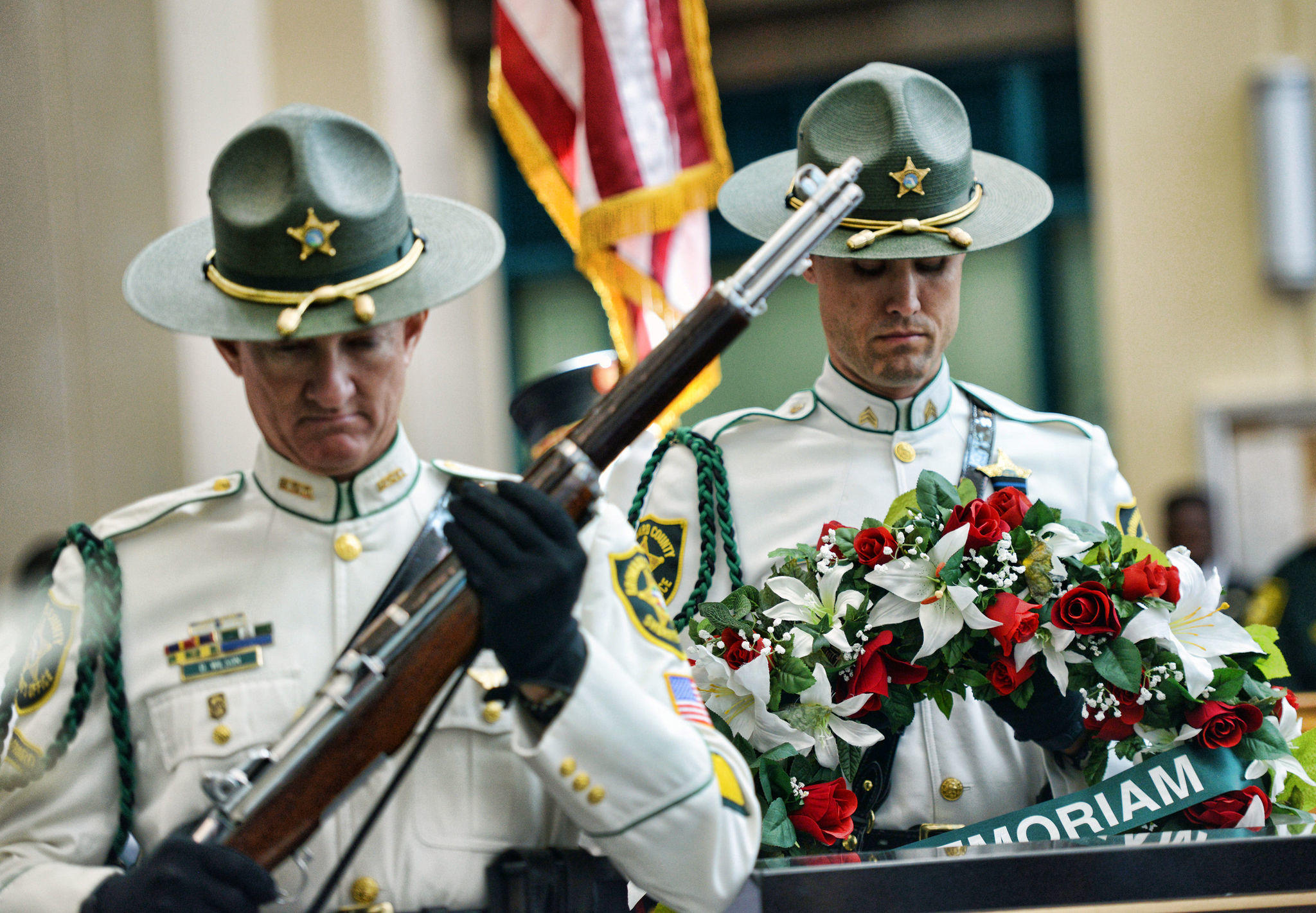 Members of the Broward sheriff's honor guard participate in a ceremony to honor fallen officers and firefighters at the Public Safety Building in Fort Lauderdale.