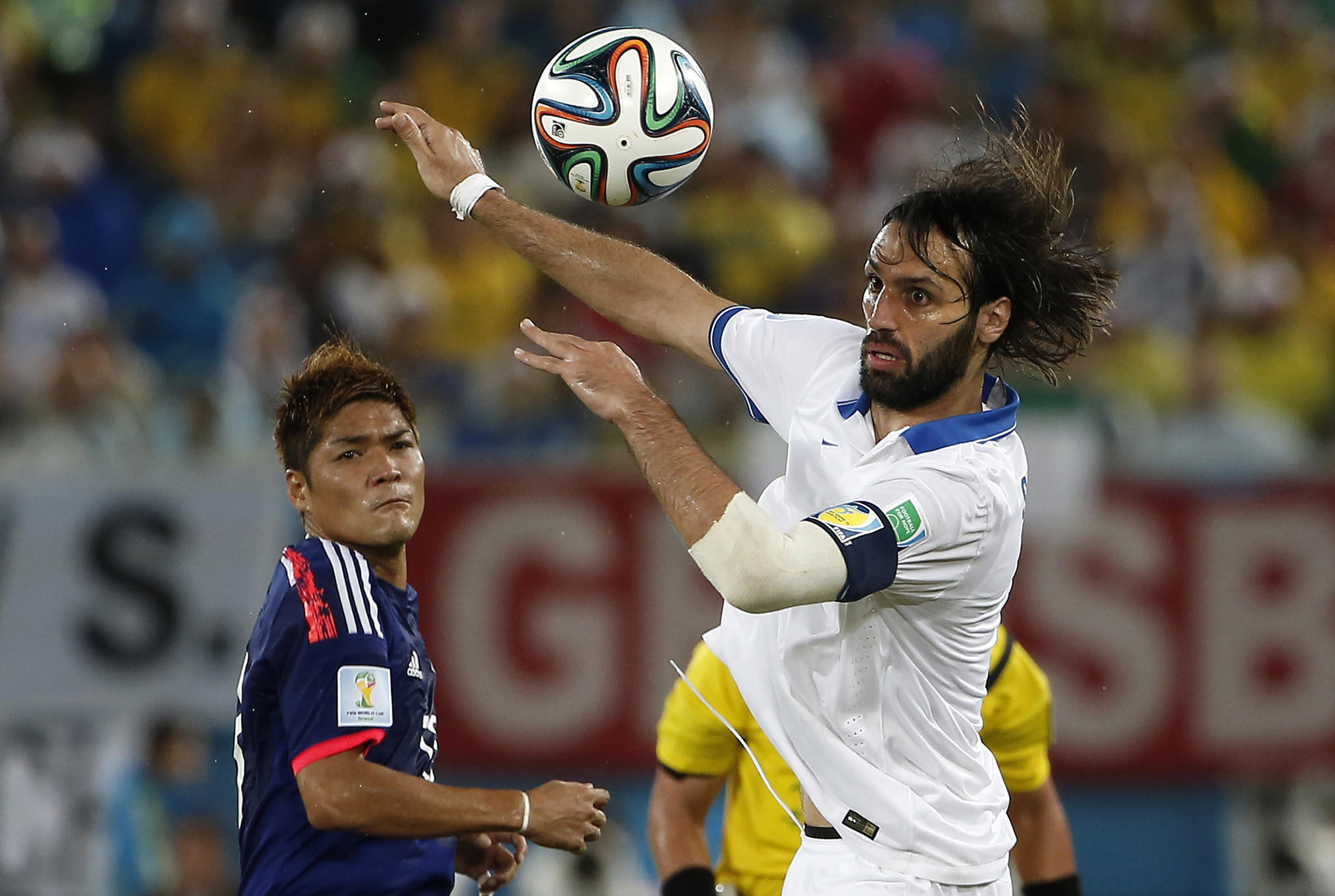 Greece forward Giorgos Samaras (7) controls the ball in front of Japan forward Yoshito Okubo (13) during the second half of their 0-0 tie.