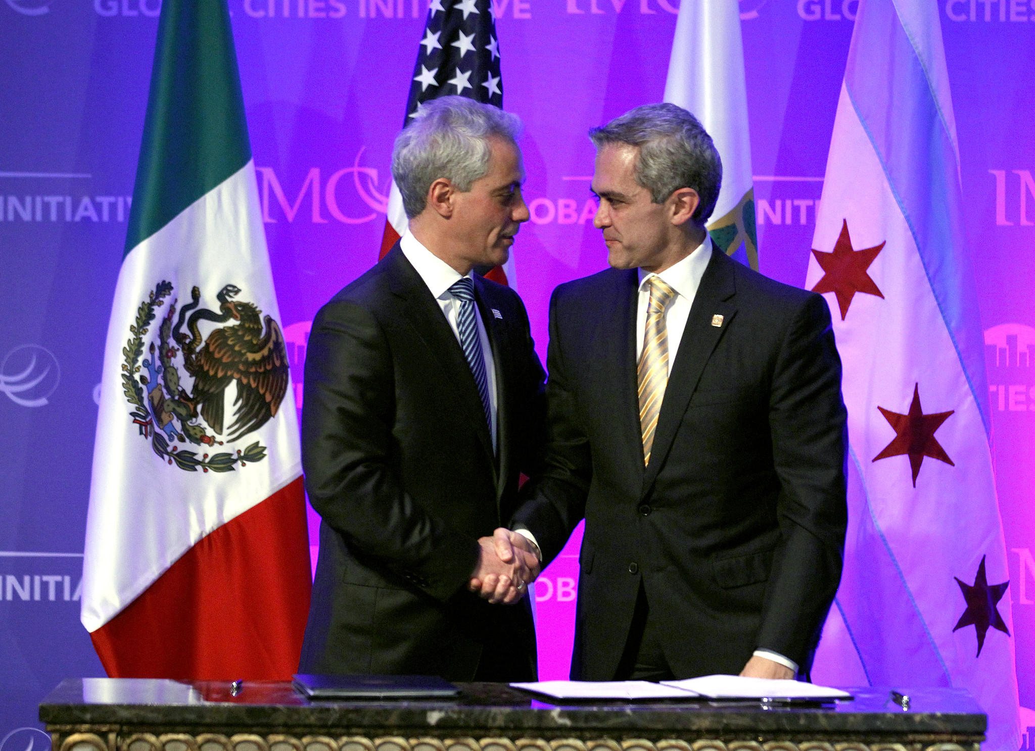 Chicago Mayor Rahm Emanuel, left, shakes hands with Mexico City Mayor Miguel Angel Mancera after signing the 'Forging A Global Cities Economic Partnership' in Mexico City.