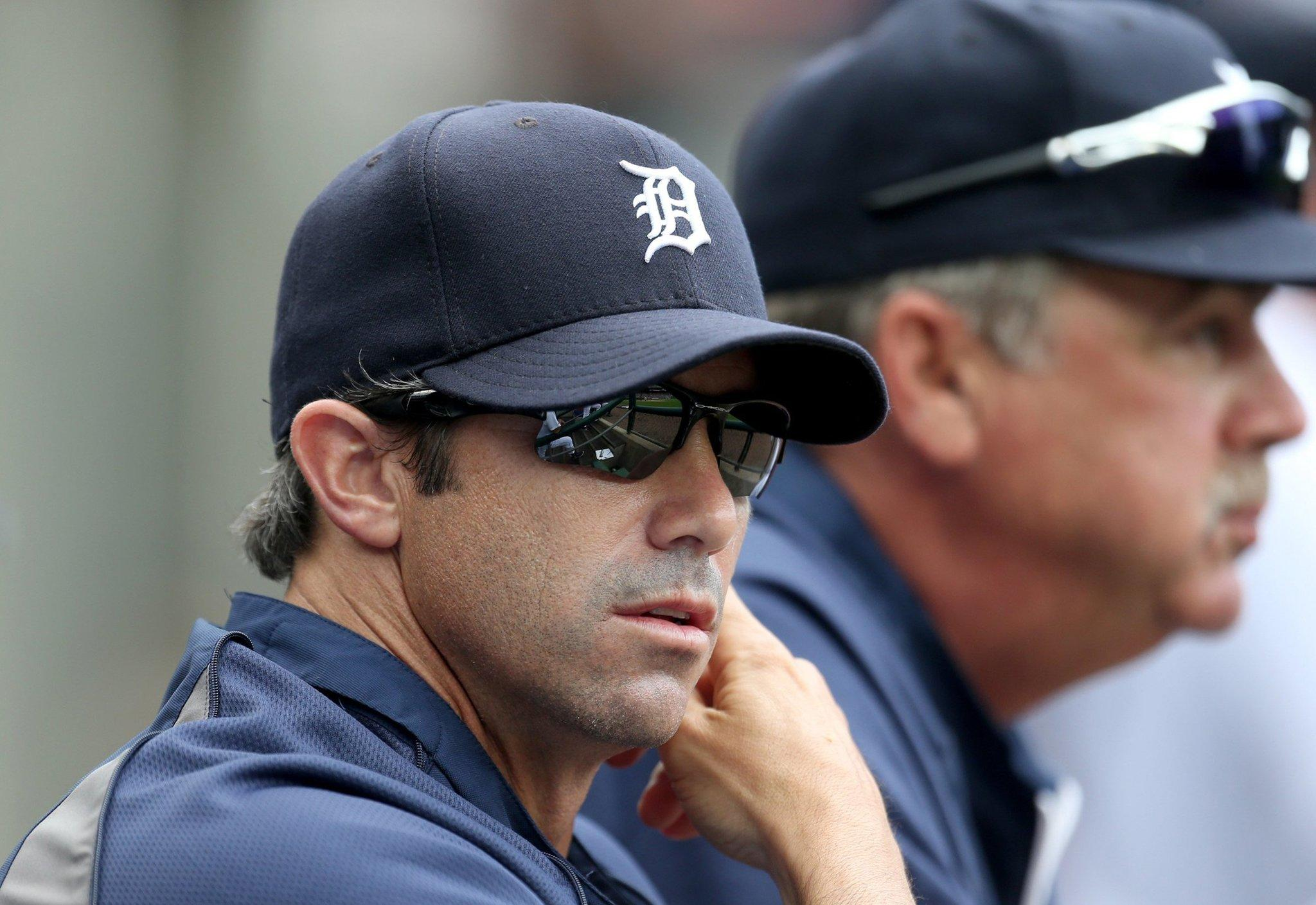 Detroit Tigers manager Brad Ausmus sits in the dugout.