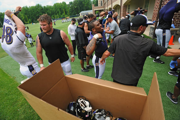 Ray Rice, Marshal Yanda and other players take off their uniforms and equipment as the minicamp wraps up.