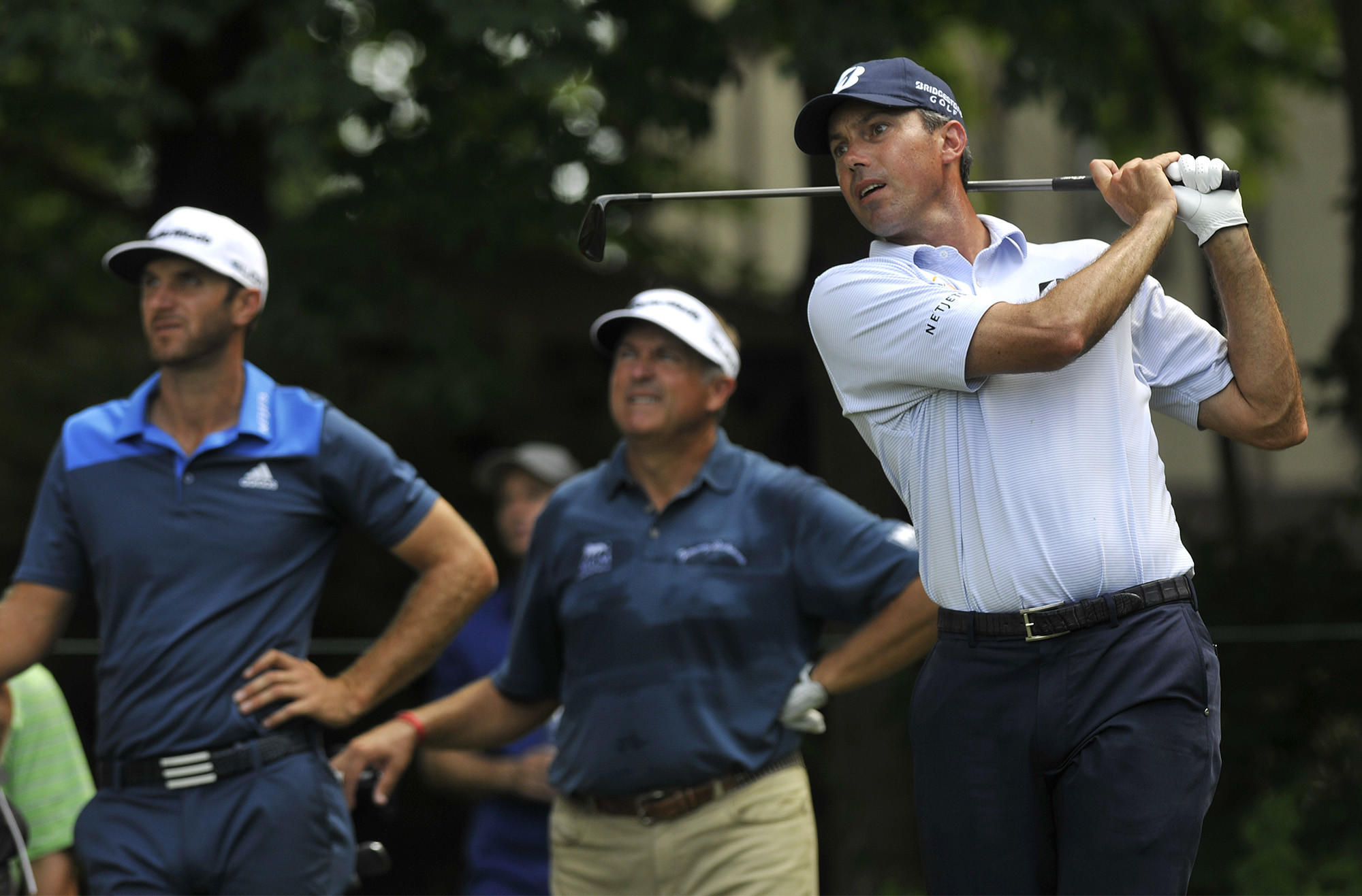 Cromwell, CT - 06/19/14 - Matt Kuchar tees off the 11th hole as Dustin Johnson, left, and Ken Duke, center, look on during the first round of the Travelers Championship at TPC River Highlands Thursday afternoon. Photo by BRAD HORRIGAN | bhorrigan@courant.com