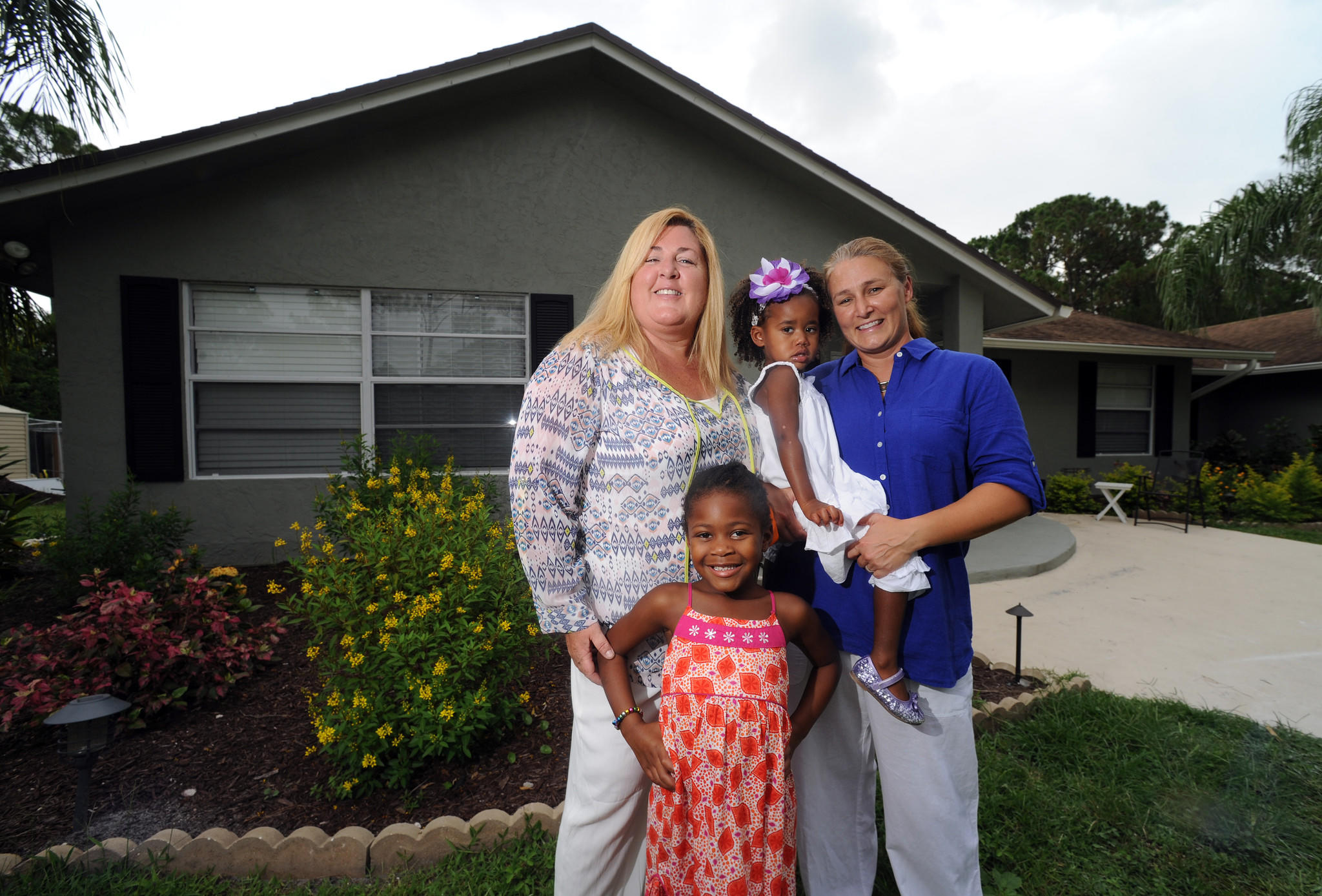 (left to right) Joyce Albu, Ava Grimsley (5 years old), Ella Grimsley (2 years old) and Sloan Grimsley. Joyce Albu and Sloan Grimsley are plaintiffs in a federal lawsuit dealing with same sex marriage. Grimsley is a firefighter and paramedic for the City of Palm Beach Gardens. They were married in New York in August 2011.(Jim Rassol, Sun Sentinel.)