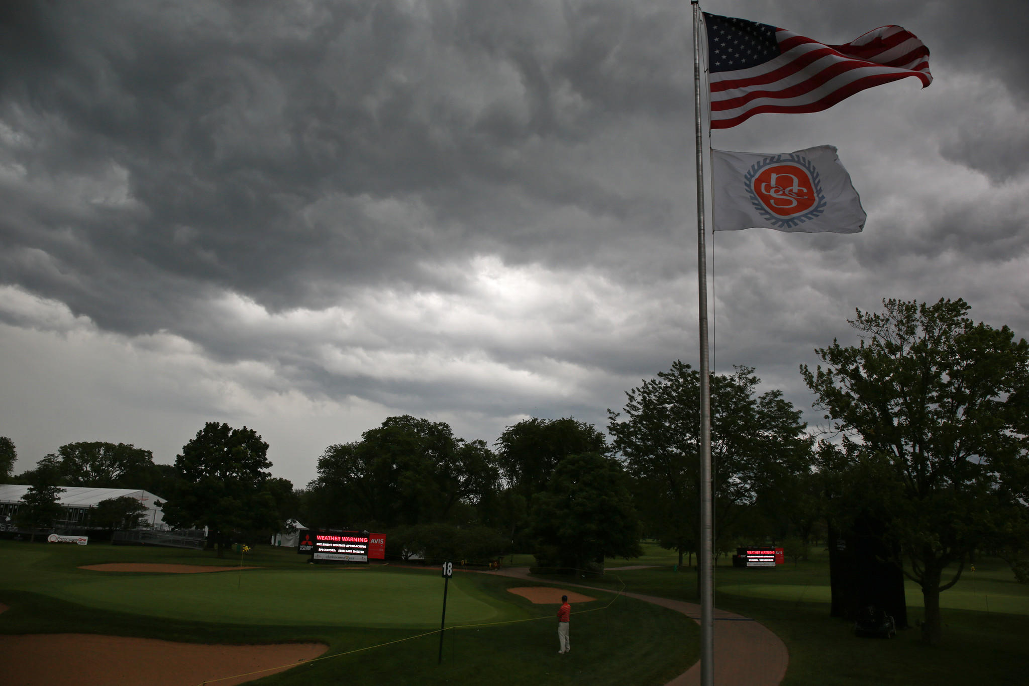 A lone golfer watches a weather system approach the 2014 Encompass Championship Pro-Am at the North Shore Country Club Wednesday.