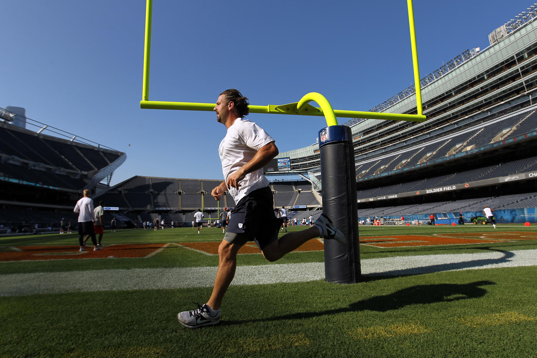 Chicago Bears' Patrick Mannelly warms up before the Bears played Cleveland in 2013.