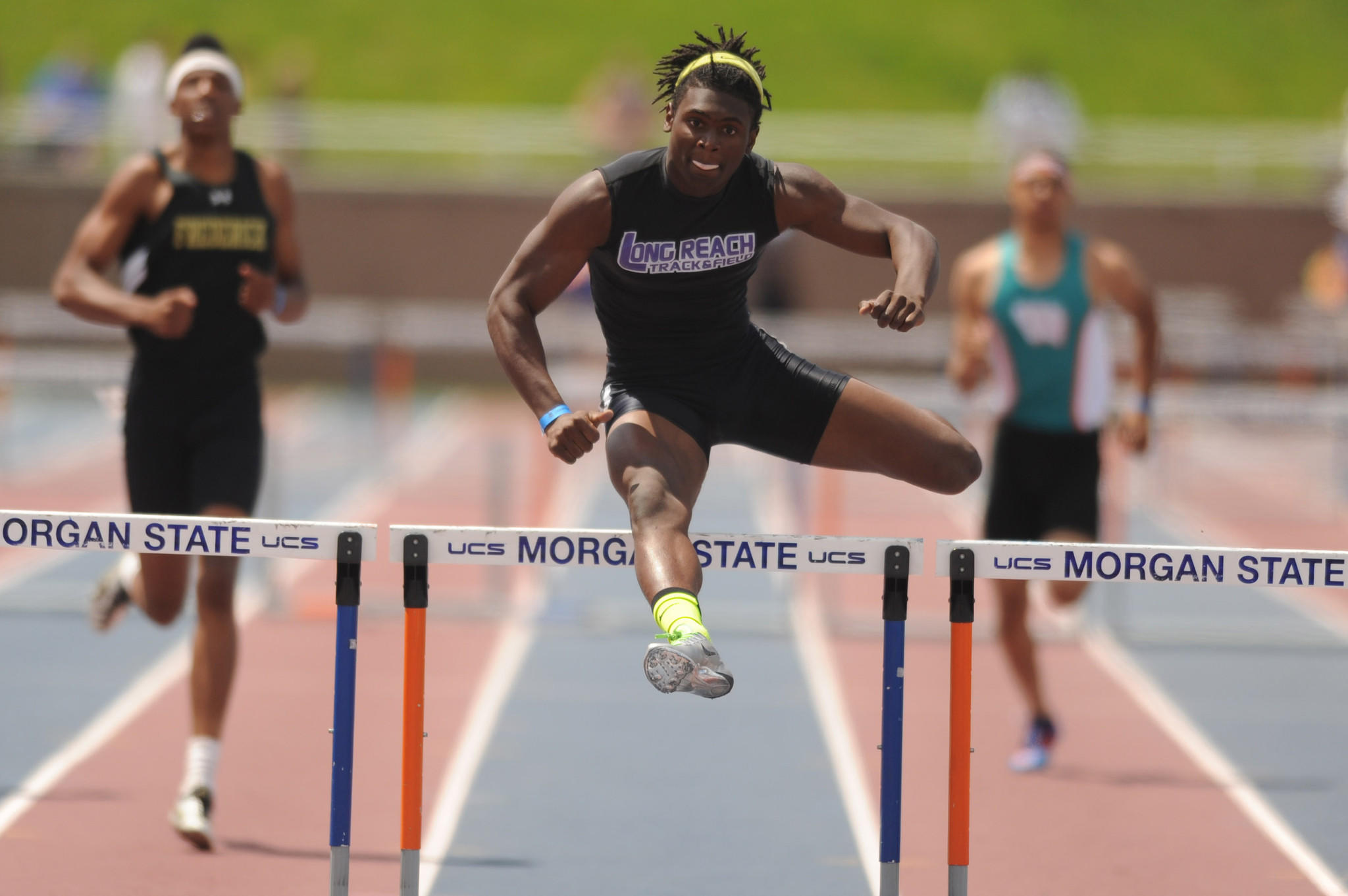 Long Reach's Robert Carter clears the final hurdle on his way to winning the Class 3A boys 300-meter hurdles during the 2014 track and field state championships at Morgan State University.