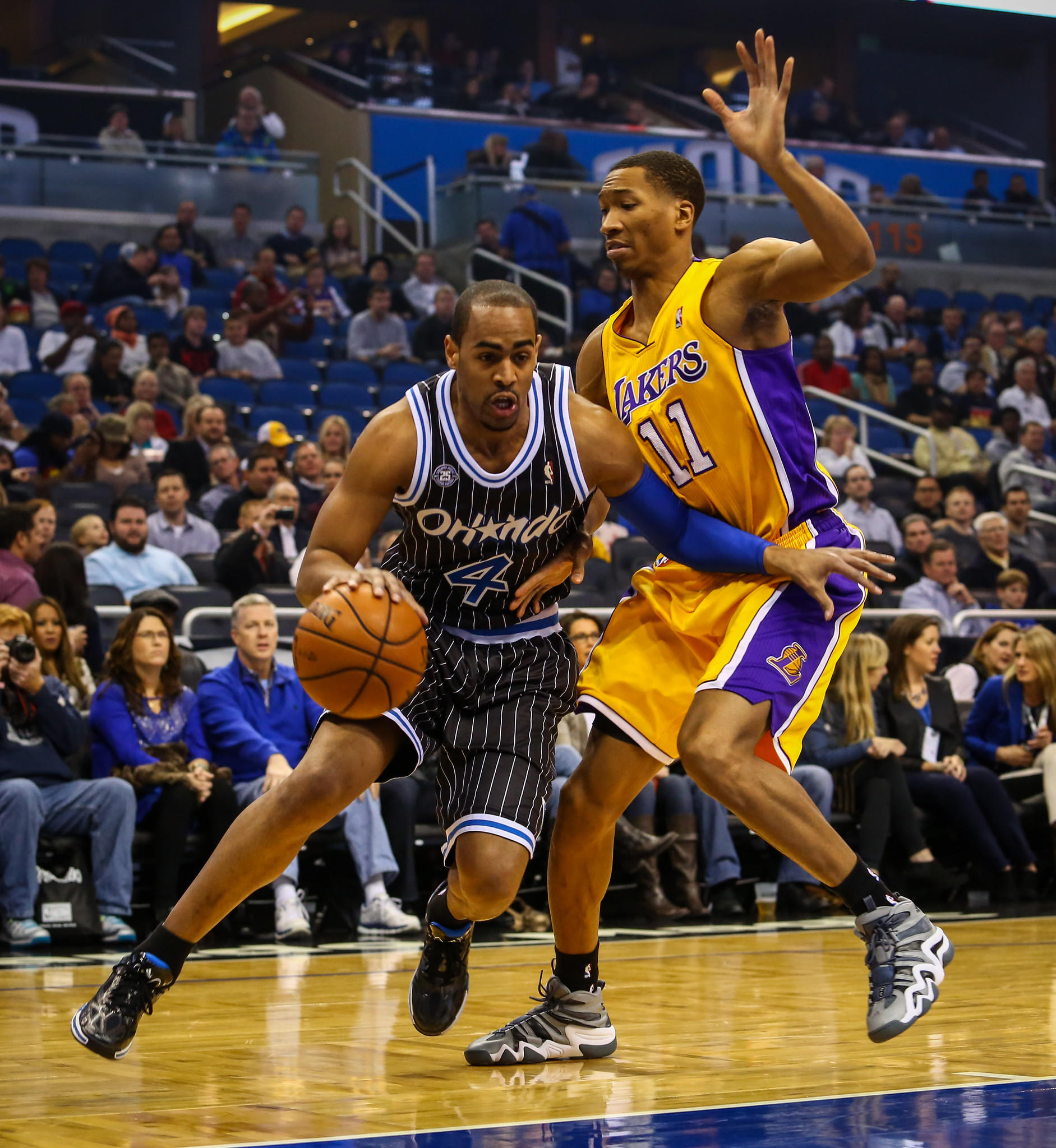 Orlando Magic forward Arron Afflalo (4) drives around the Lakers' Wesley Johnson (11) during first quarter action of an NBA game against the Los Angeles Lakers at Amway Center in Orlando, Fla. on Friday, January 24, 2014.