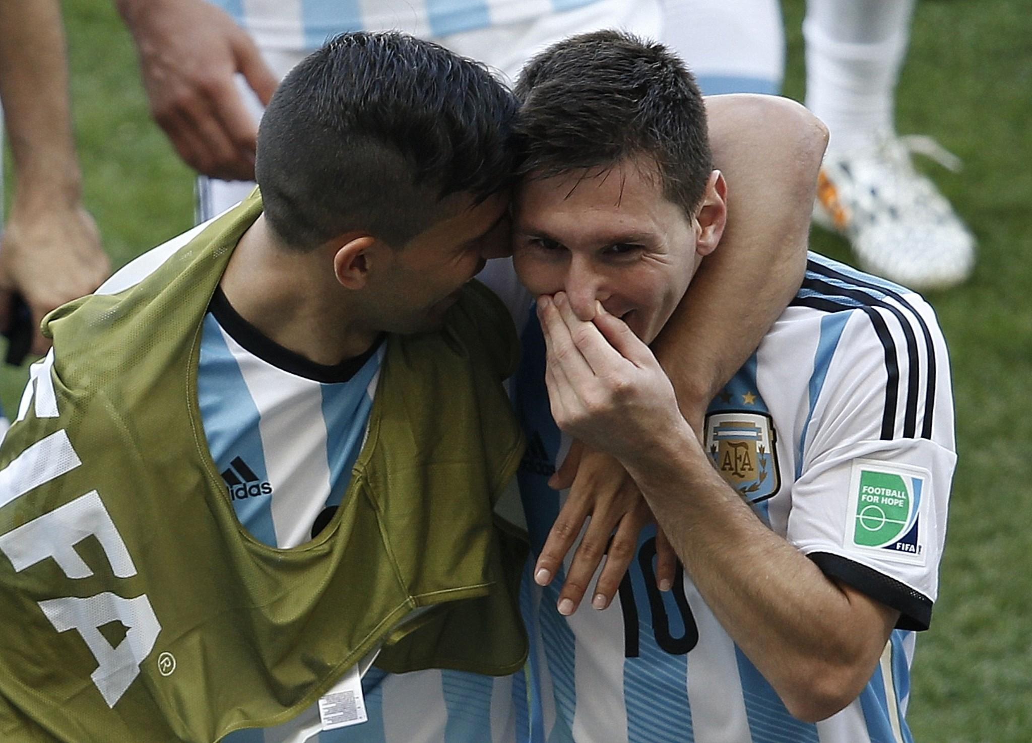 Argentina's forward and captain Lionel Messi(R) celebrates with Argentina's forward Sergio Aguero after the Group F football match between Argentina and Iran at the Mineirao Stadium in Belo Horizonte during the 2014 FIFA World Cup in Brazil on June 21, 2014.