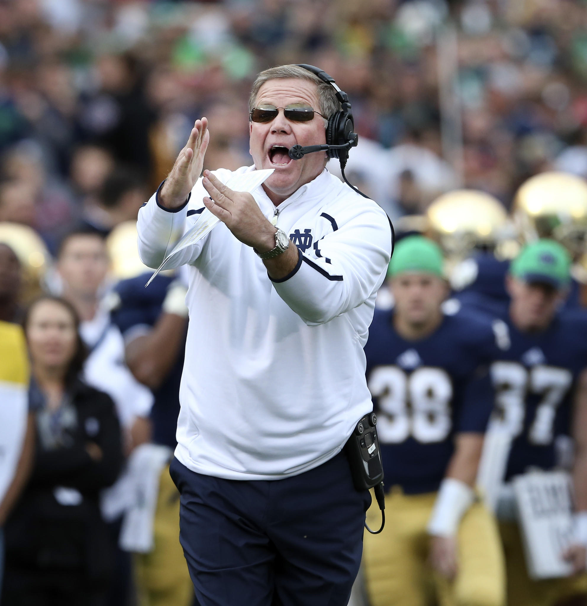 Notre Dame Fighting Irish coach Brian Kelly, calls time out just before the end of the second quarter against the Michigan State Spartans, at Notre Dame Stadium, in South Bend, Ind., on Saturday Sept. 21, 2013.