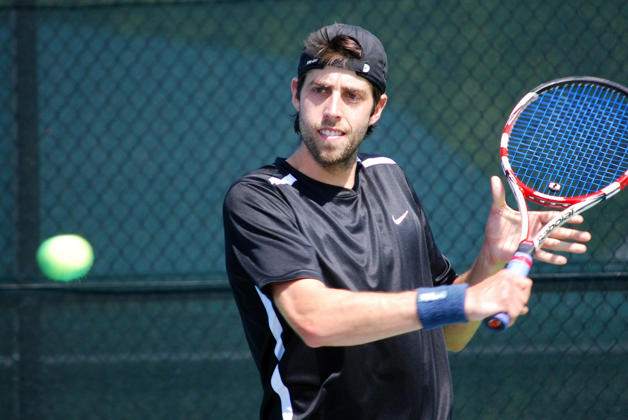 Xander Centenari prepares to hit a slice backhand at College Park Tennis Club during the U.S. Open National Playoffs Mid-Atlantic Sectional Qualifying tournament. Centenari, 24, of Towson, won the men's singles title and a spot in the U.S. Open National Playoffs Championships.