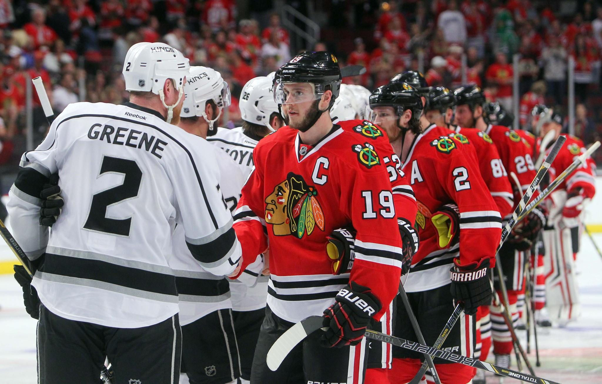 Chicago Blackhawks center Jonathan Toews (19) shakes hands with Los Angeles Kings defenseman Matt Greene (2) after game seven of the Western Conference Final of the 2014 Stanley Cup Playoffs at United Center.
