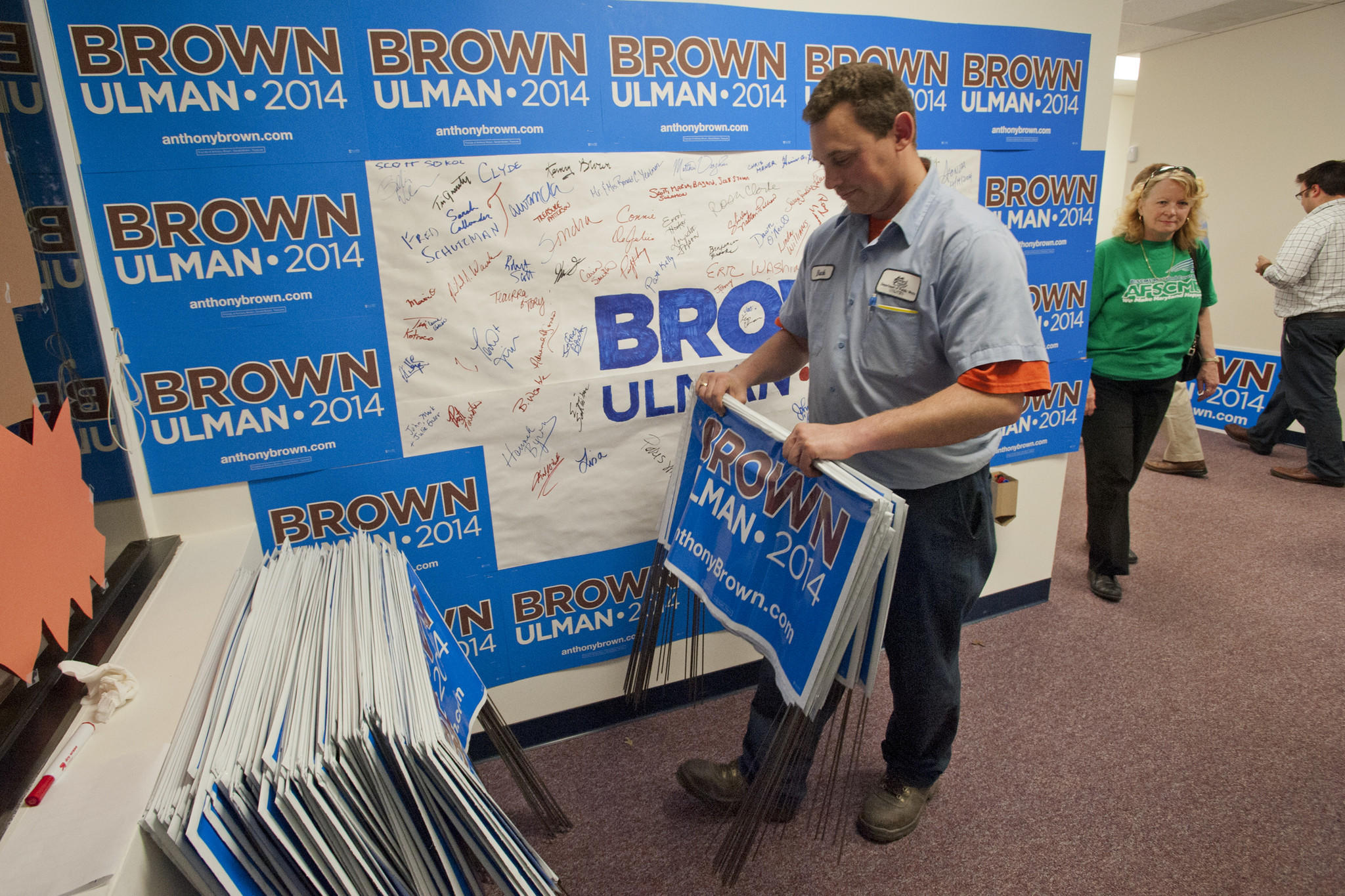 Rob Buck, an AFSCME volunteer, stacks completed lawn signs by the door of the Baltimore County Field Office for Anthony Brown-Ken Ulman at 1840 York Road. Volunteers were putting together lawn signs and working the phone bank.