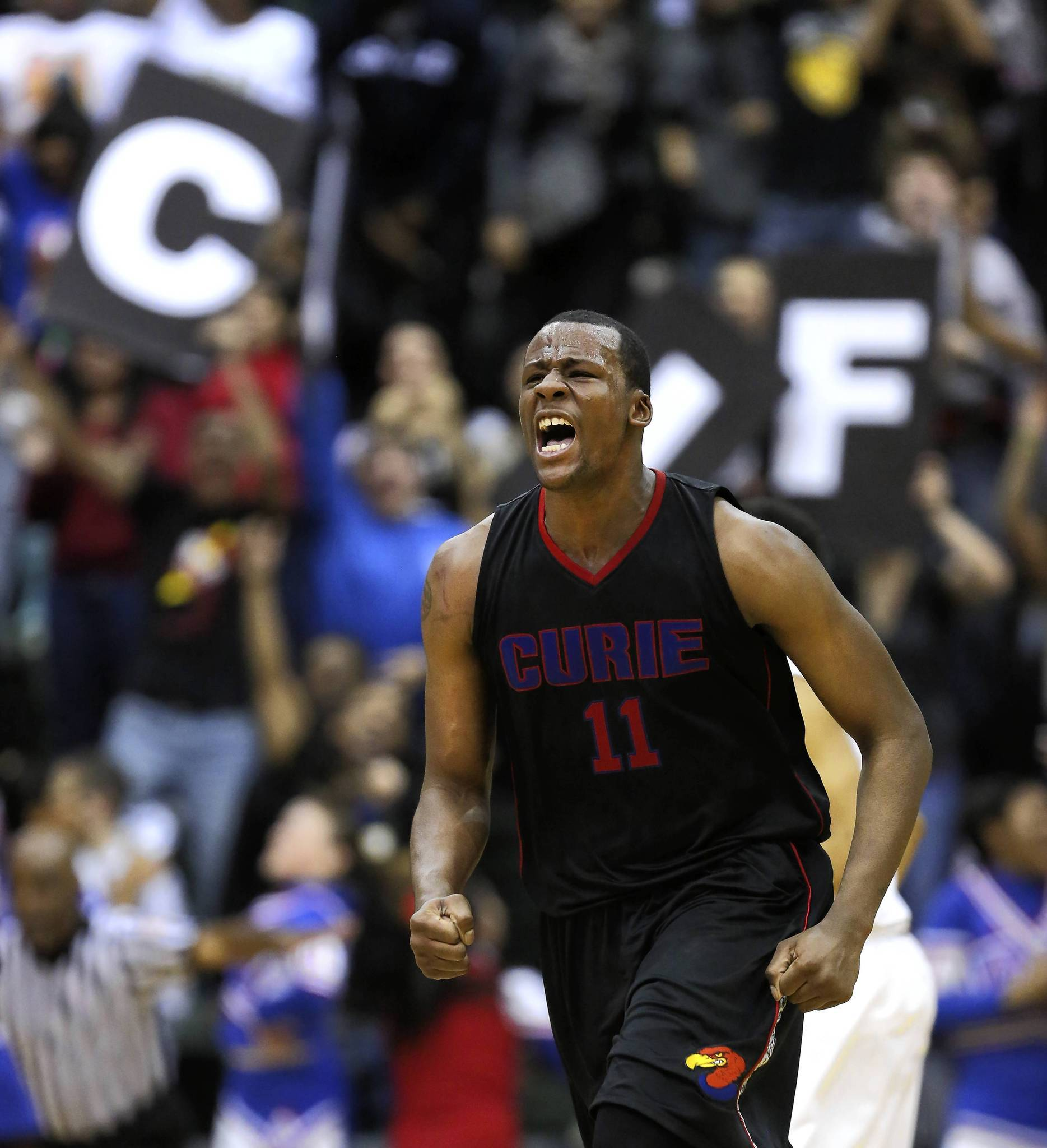 Curie's Cliff Alexander celebrates after scoring against Whitney Young in the public league playoff final at Chicago State University on Friday, February 21, 2014.