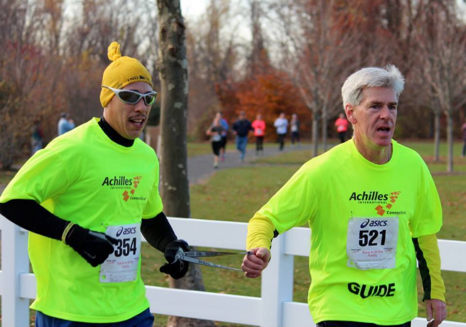 David Alejandro, left, a visually impaired runner from Naugatuck and an Achilles Club member, runs in a race with guide Chris Deneen.