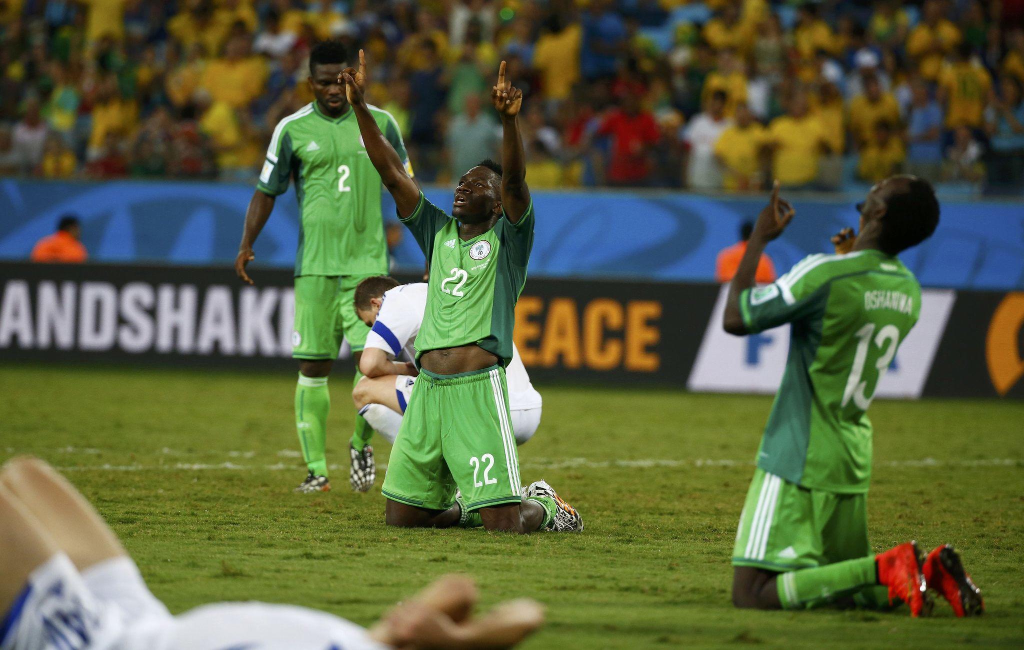 Nigeria's Kenneth Omeruo (C) and Juwon Oshaniwa (R) celebrate their victory over Bosnia.