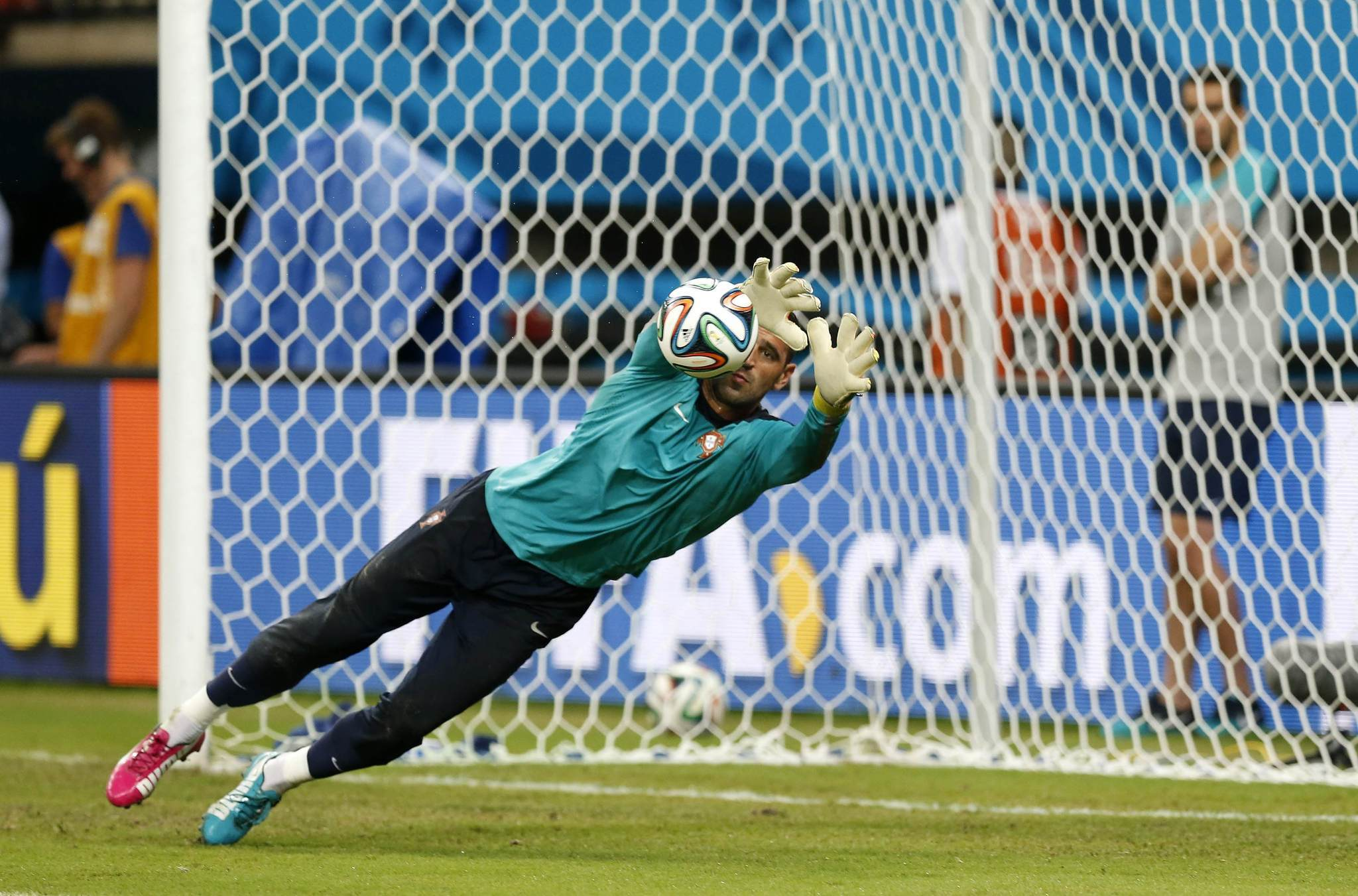 Portugal's goalkeeper Eduardo makes a save during team training at Arena da Amazonia stadium where Portugal will play against USA on June 22 during the Brazil 2014 World Cup, in Manaus June 21, 2014.