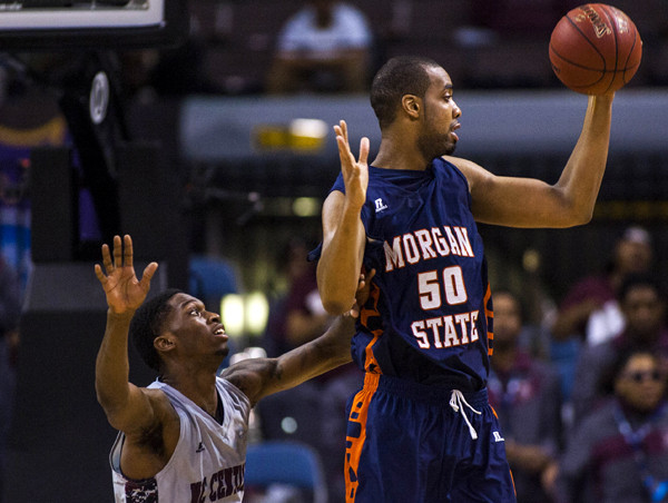 Morgan State center Ian Chiles, right, handles the ball against North Carolina Central guard Jordan Parks in the MEAC championship game at the Norfolk Scope Arena.