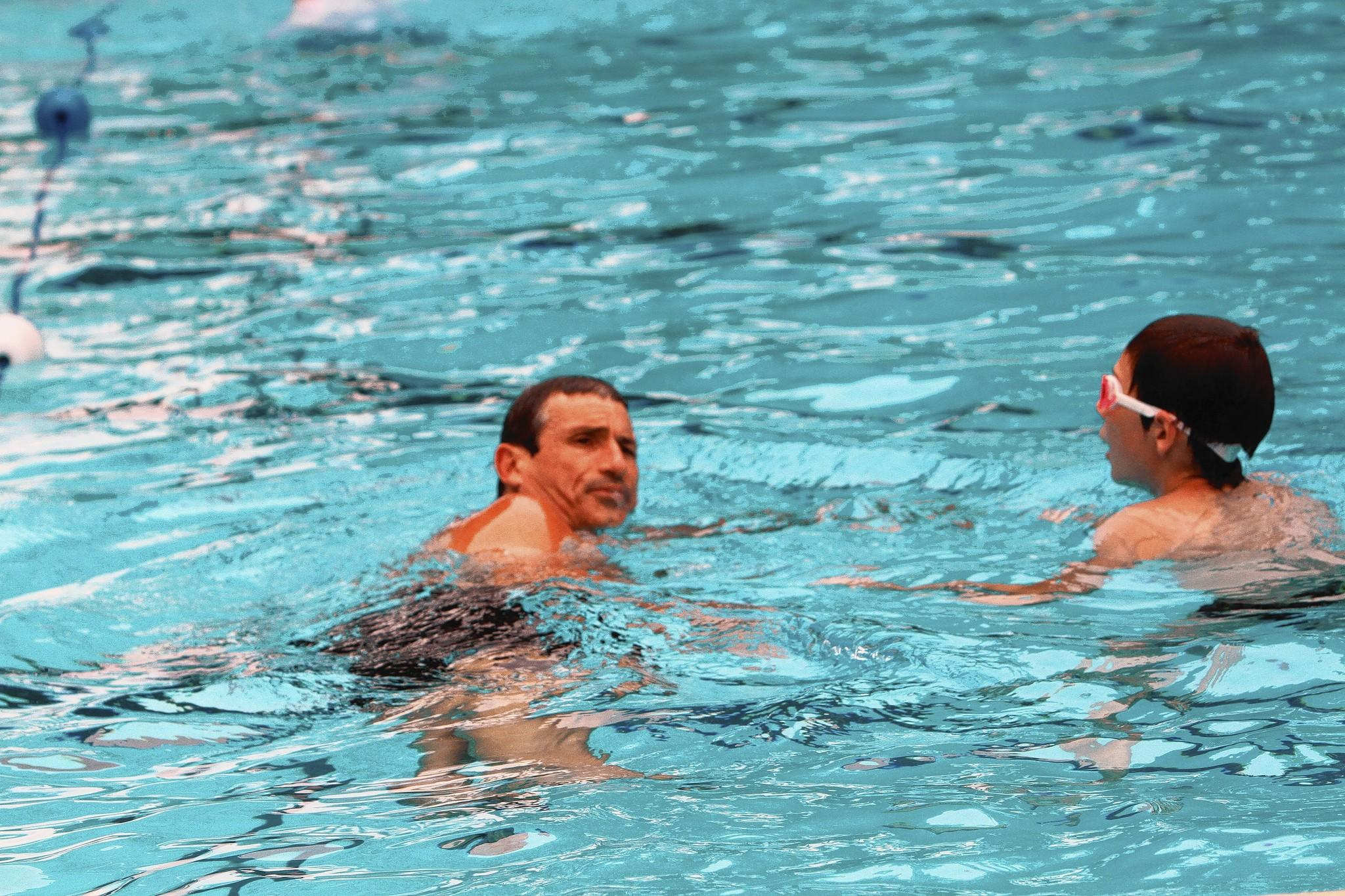 Dominick Castellano coaches his son, Brock Castellano, at the College Park Community Pool.