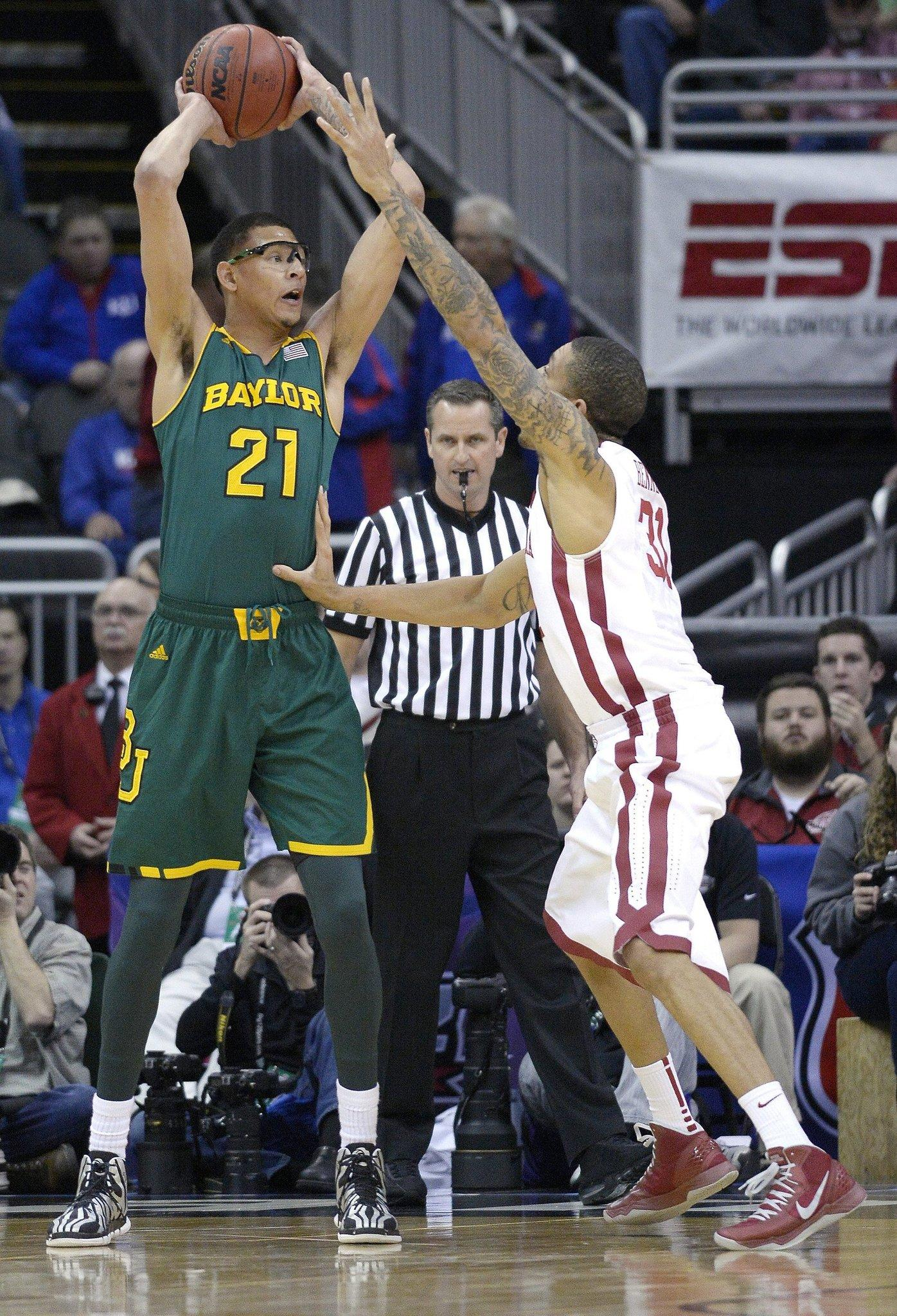 Baylor's Isaiah Austin looks to pass over Oklahoma's D.J. Bennett during the Big 12 Tournament at the Sprint Center.