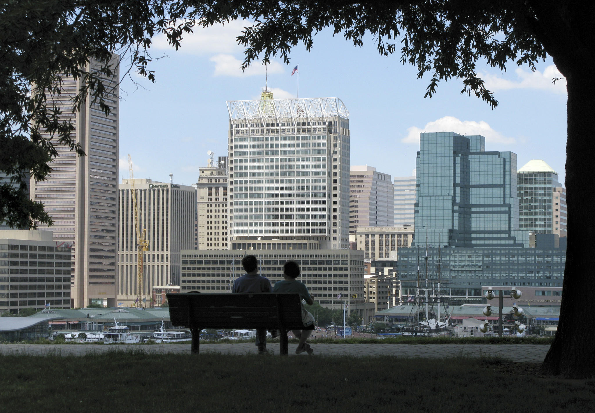 A couple enjoy the view of the Baltimore skyline from the park on Federal Hill.