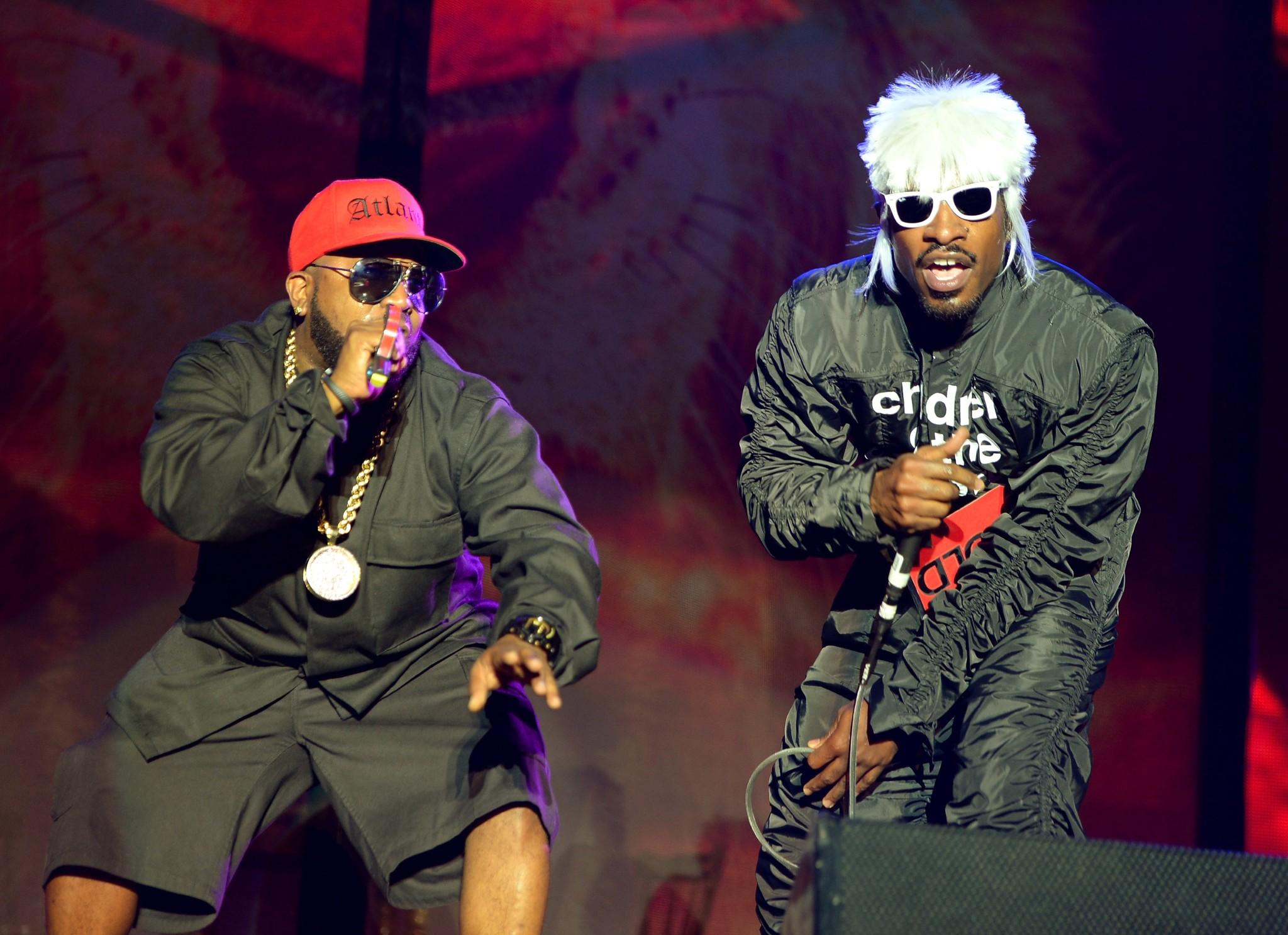 Big Boi (L) and Andre 3000 of Outkast perform onstage during day 3 of the Firefly Music Festival on June 21, 2014 in Dover, Delaware.
