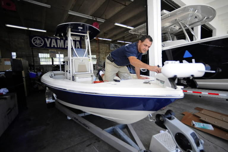 Tuppen's Marine and Tackle mechanic Tony Maldonado makes final checks on a new boat being prepared for delivery to its owner. The Pathfinder 2400 is custom rigged with a 300HP Yamaha outboard, trolling motor and electronics.