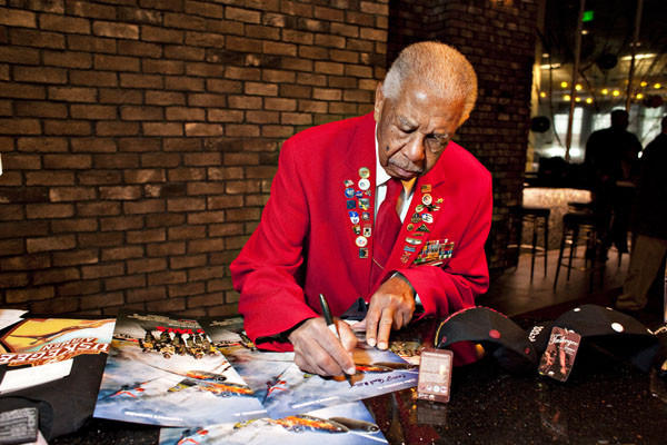 Grant S. Williams Sr. of Hampton, a member of the famed Tuskegee Airmen who worked to spread the story of the African-American air combat group, has died, according to a post on the group's Tidewater chapter website. Williams is shown signing an autograph on movie posters in this 2012 photo.