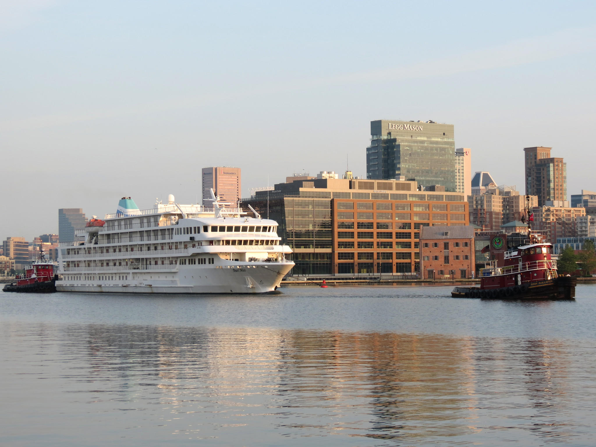 The unfinished cruise ship Pearl Mist is towed from Baltimore on June 9, 2013.