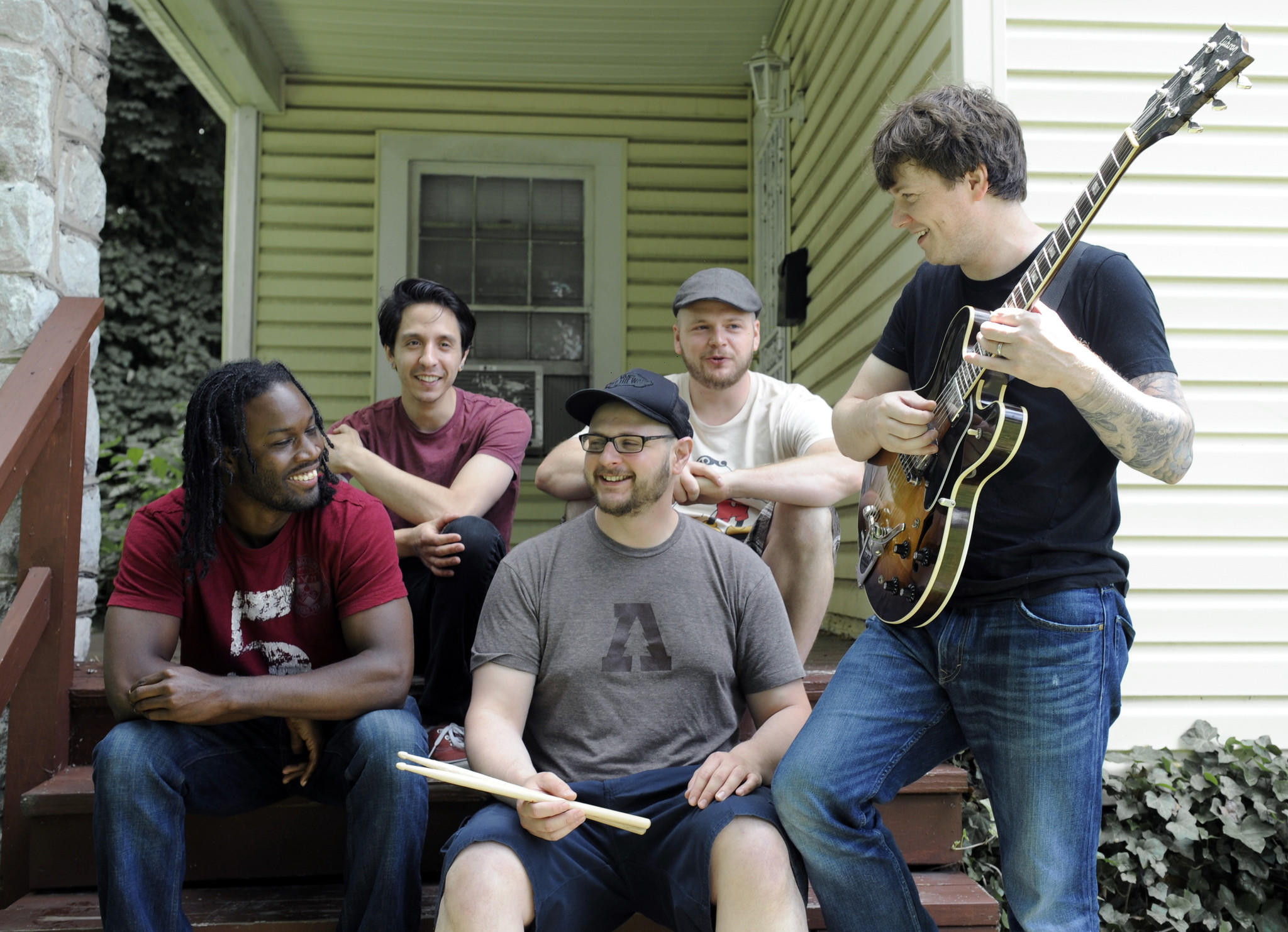 Vinny Vegas (L-R: Emmanuel Lee, Scott Siskind, Jason Cohen, Travis Lockhart and Earl Carter) pose in front of the band's practice space in Evesham Park.