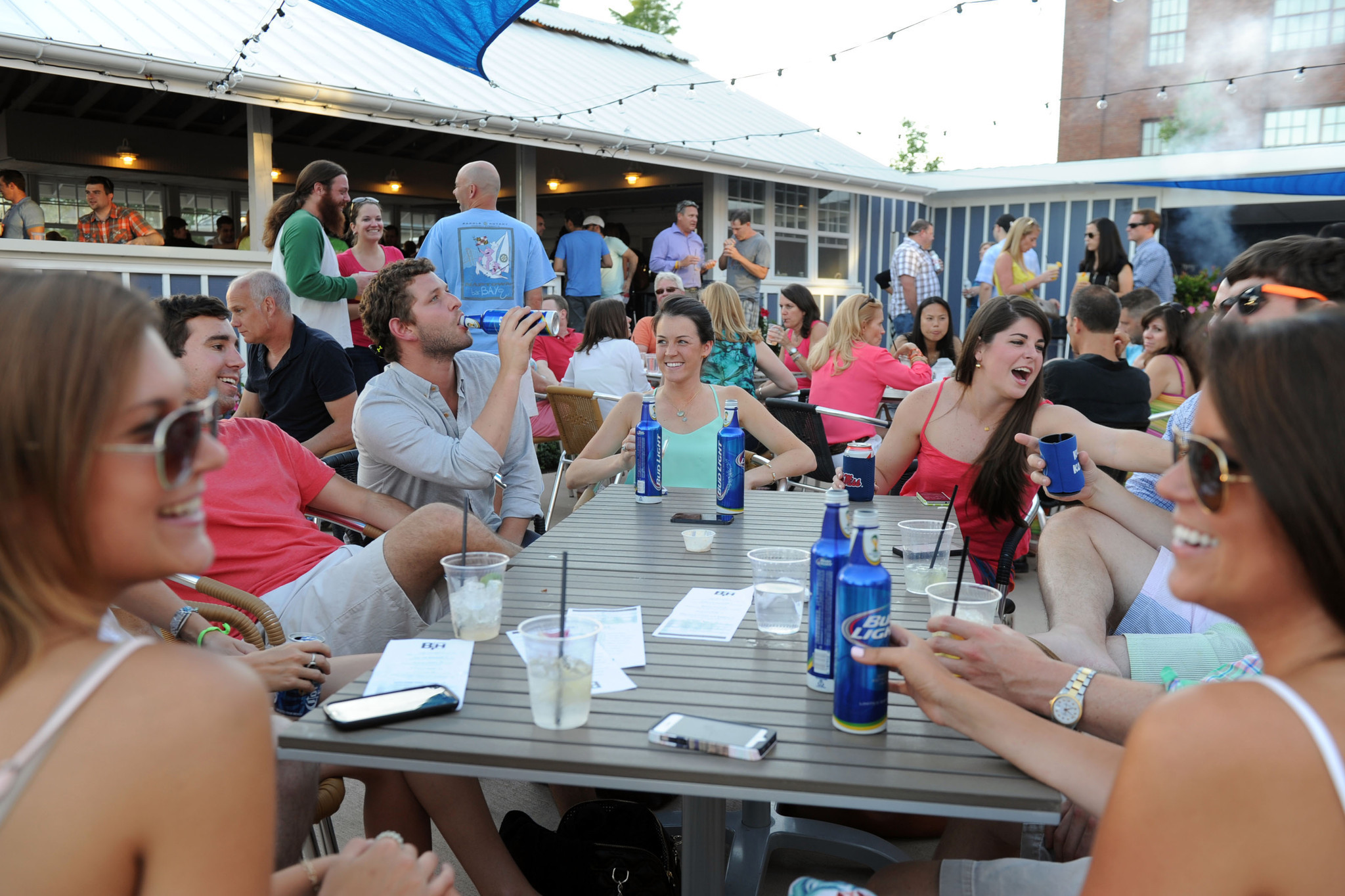 Patrons enjoy the patio area at Boathouse Canton on a Friday evening.