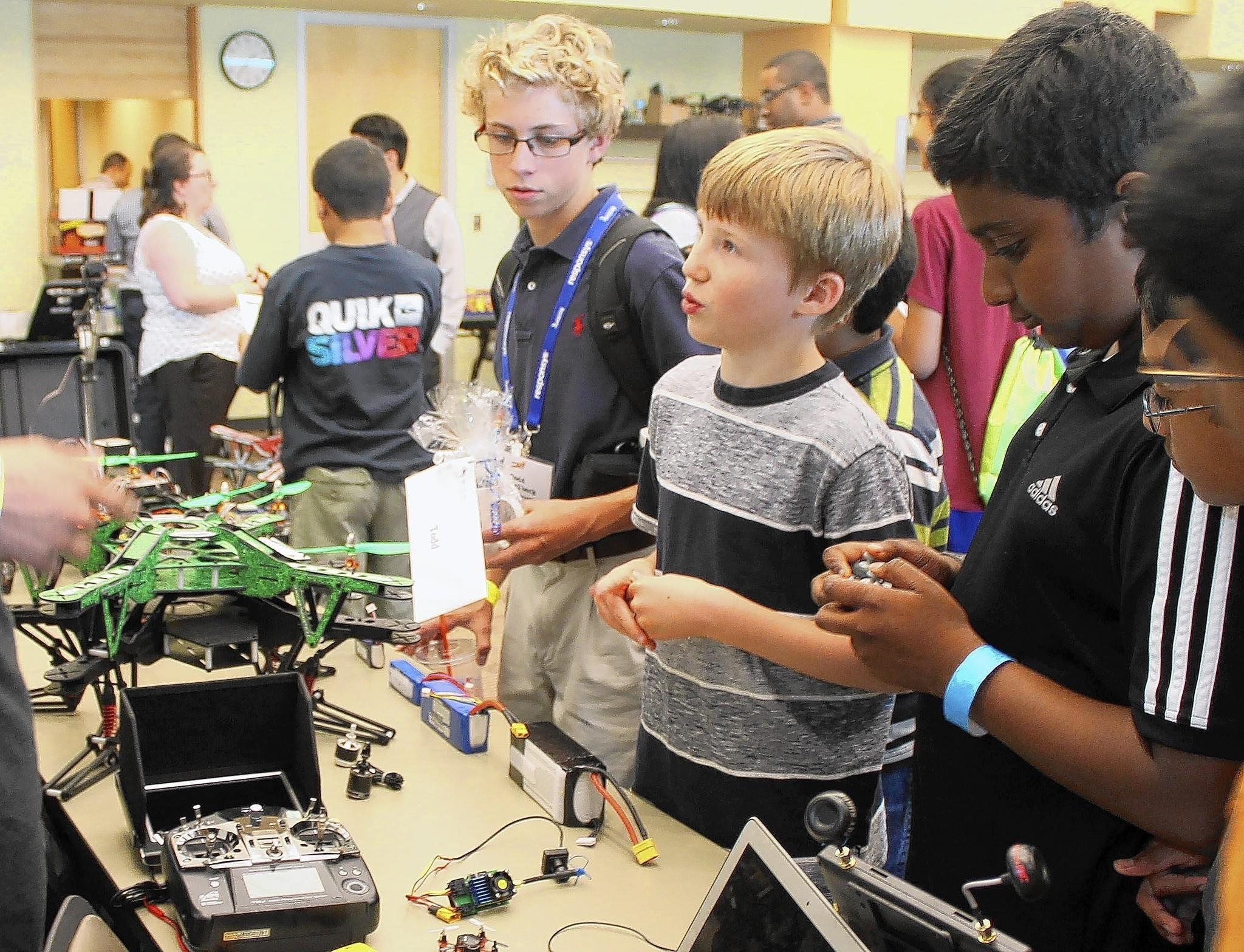 Teens from around the Naperville area ask questions about drone technology at Teen Ignite.