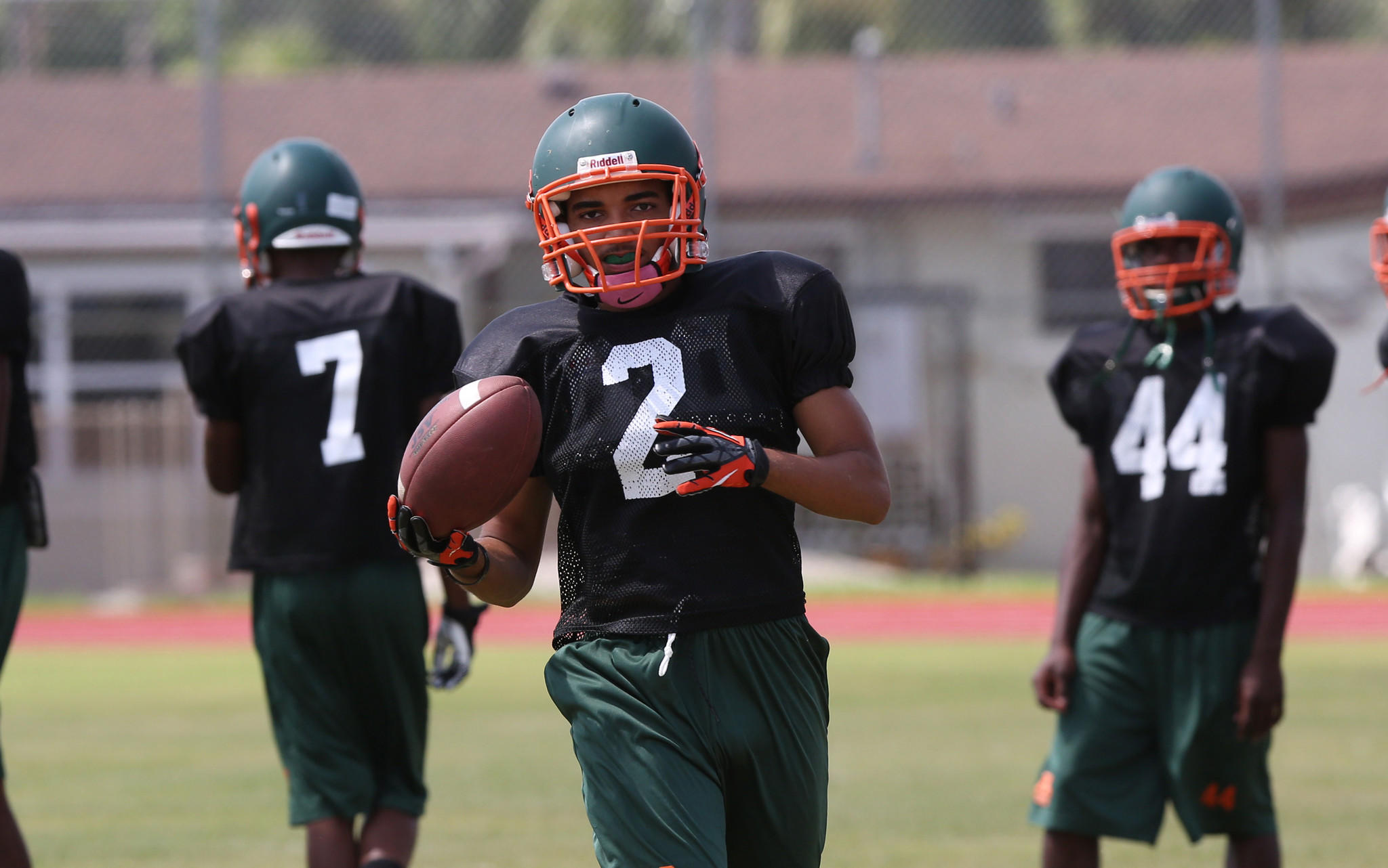 McArthur is one of the teams playing this weekend. Malik Wisdom of McArthur warms up during spring drills.