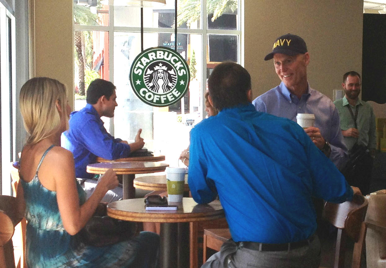Gov. Rick Scott, in Navy cap, talks to constituents during a stop at a Fort Lauderdale Starbucks on June 24, 2014. (Photo by Juan Ortega)