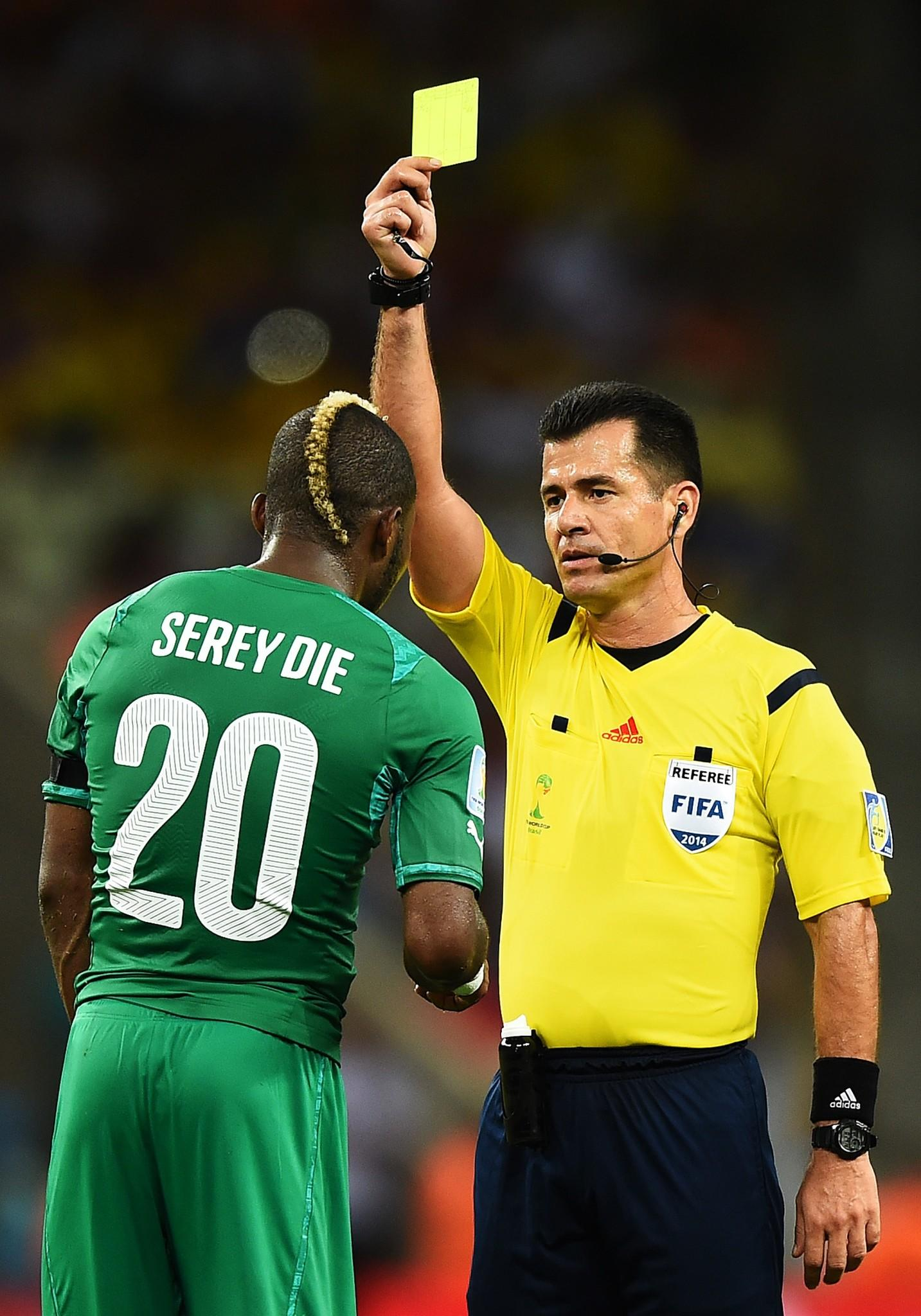Die Serey of the Ivory Coast is shown a yellow card by referee Carlos Vera during the 2014 FIFA World Cup Brazil Group C match between Greece and the Ivory Coast.