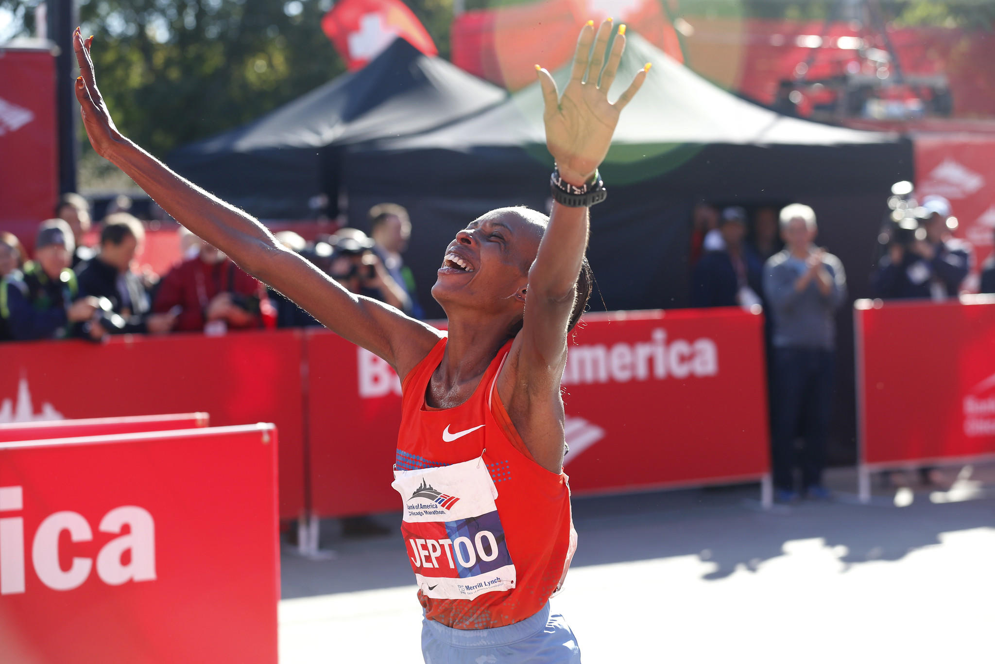 Rita Jeptoo exults after winning the 2013 Bank of America Chicago Marathon.