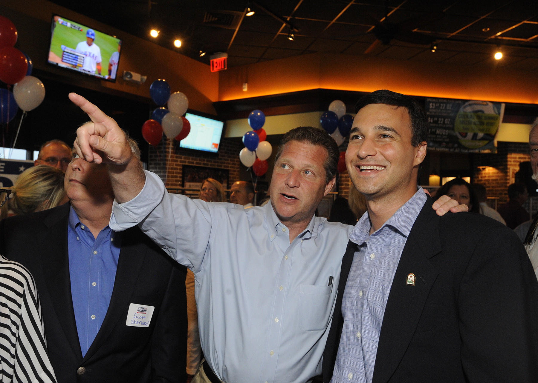 County Executive candidate Steve Schuh looks at the incoming election results with Annapolis City Mayor Mike Pantelides while at the Greene Turtle in Pasadena on Tuesday evening for County Executive candidate Steve Schuh's campaign.